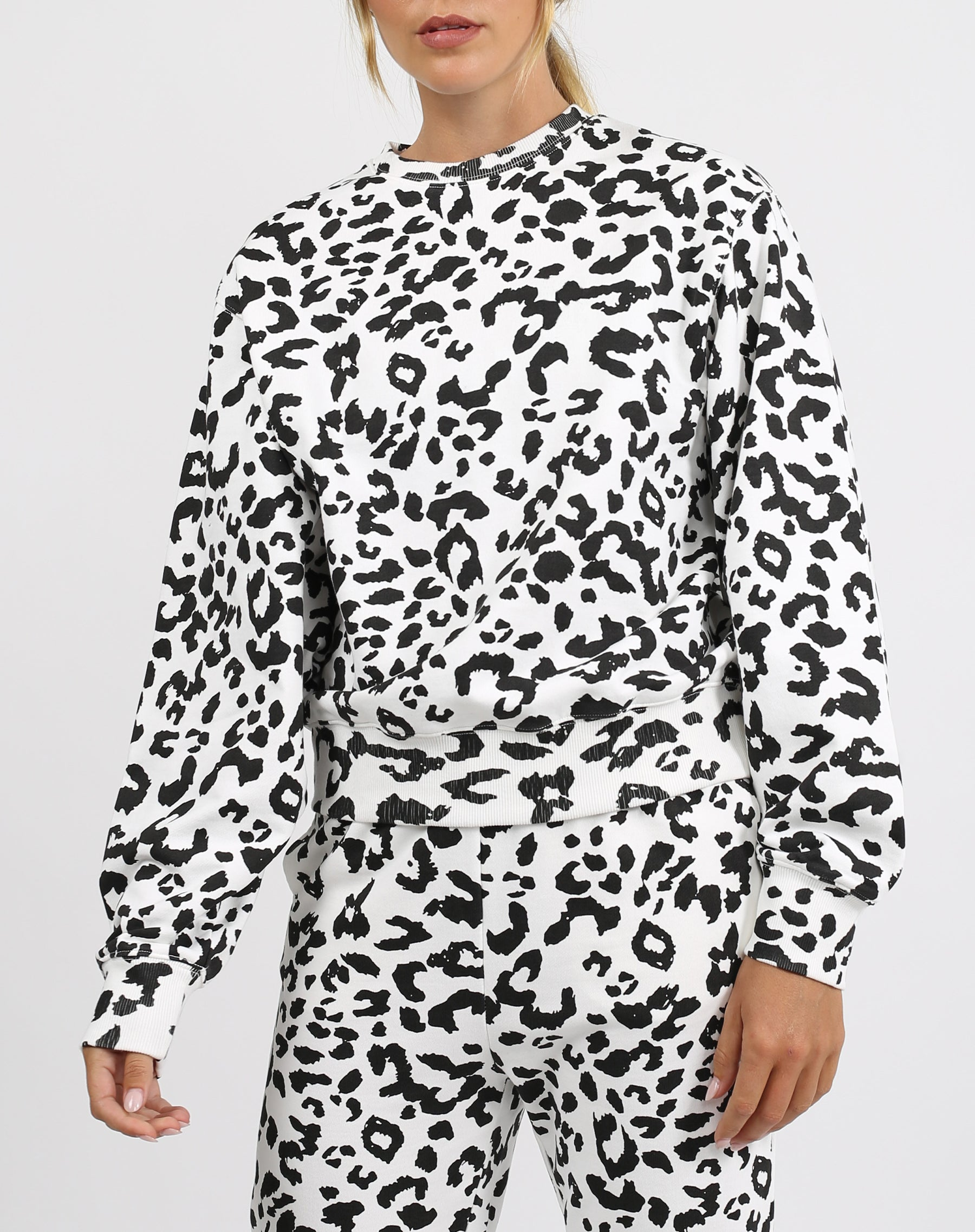 This is an image of the Babes Social Club Best Friend Crew Neck Sweater in Snow Leopard by Brunette the Label.