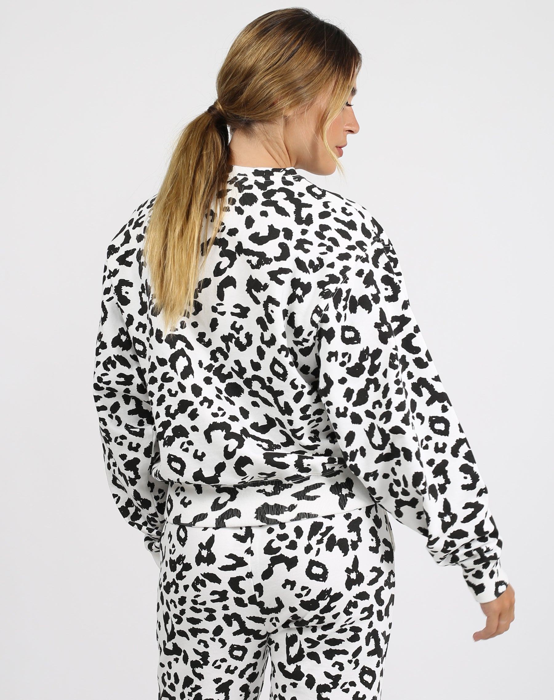 This is an image of the back of the Babes Social Club Best Friend Sweatsuit in Snow Leopard by Brunette the Label.