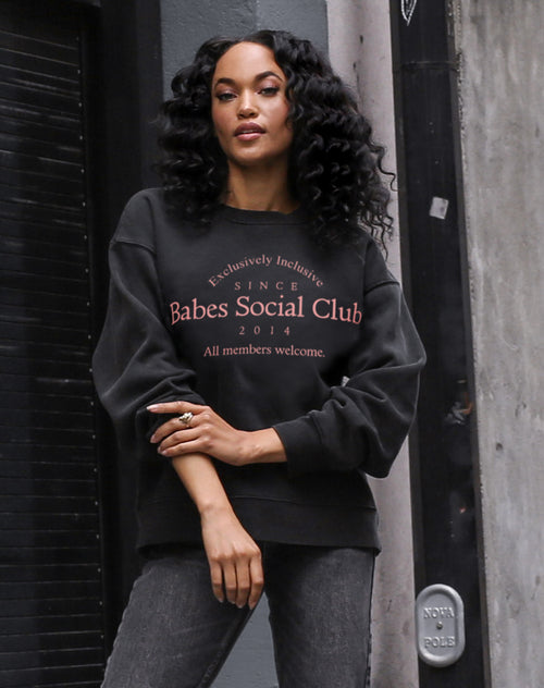 This is a photo of a model wearing the babes social cub step sister crew in acid wash by Brunette the Label.