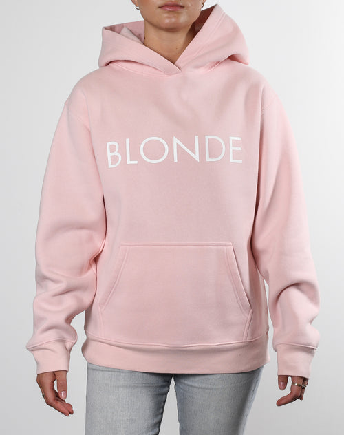 This is an Ecommerce photo of a model wearing the Blonde Classic Hoodie in Ballet Slipper by Brunette the Label