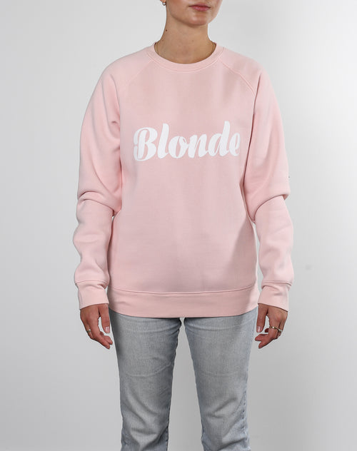 This is an Ecommerce photo of a model wearing the Blonde Cursive Classic Crew in Ballet Slipper by Brunette the Label.