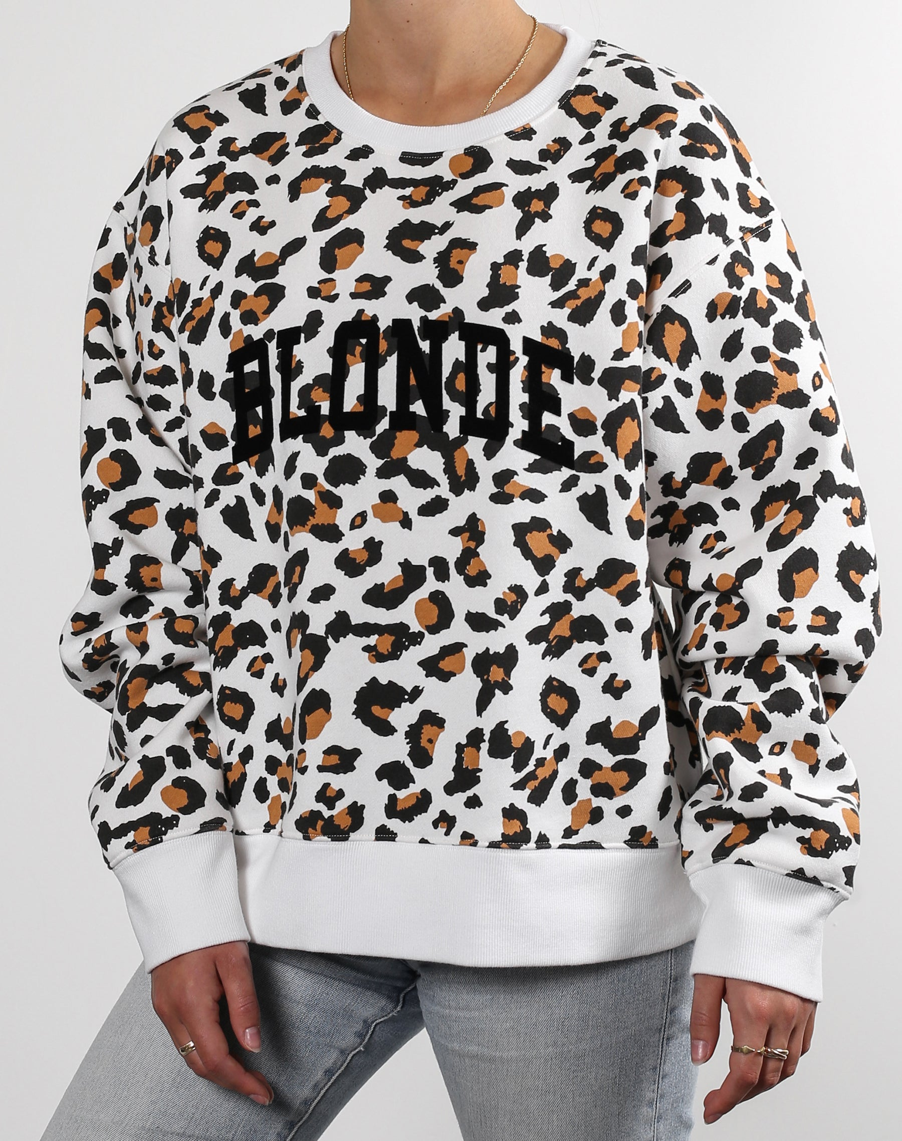 This is an Ecommerce photo of the Blonde Step Sister Crew Neck Sweatshirt in White Leopard by Brunette the Label