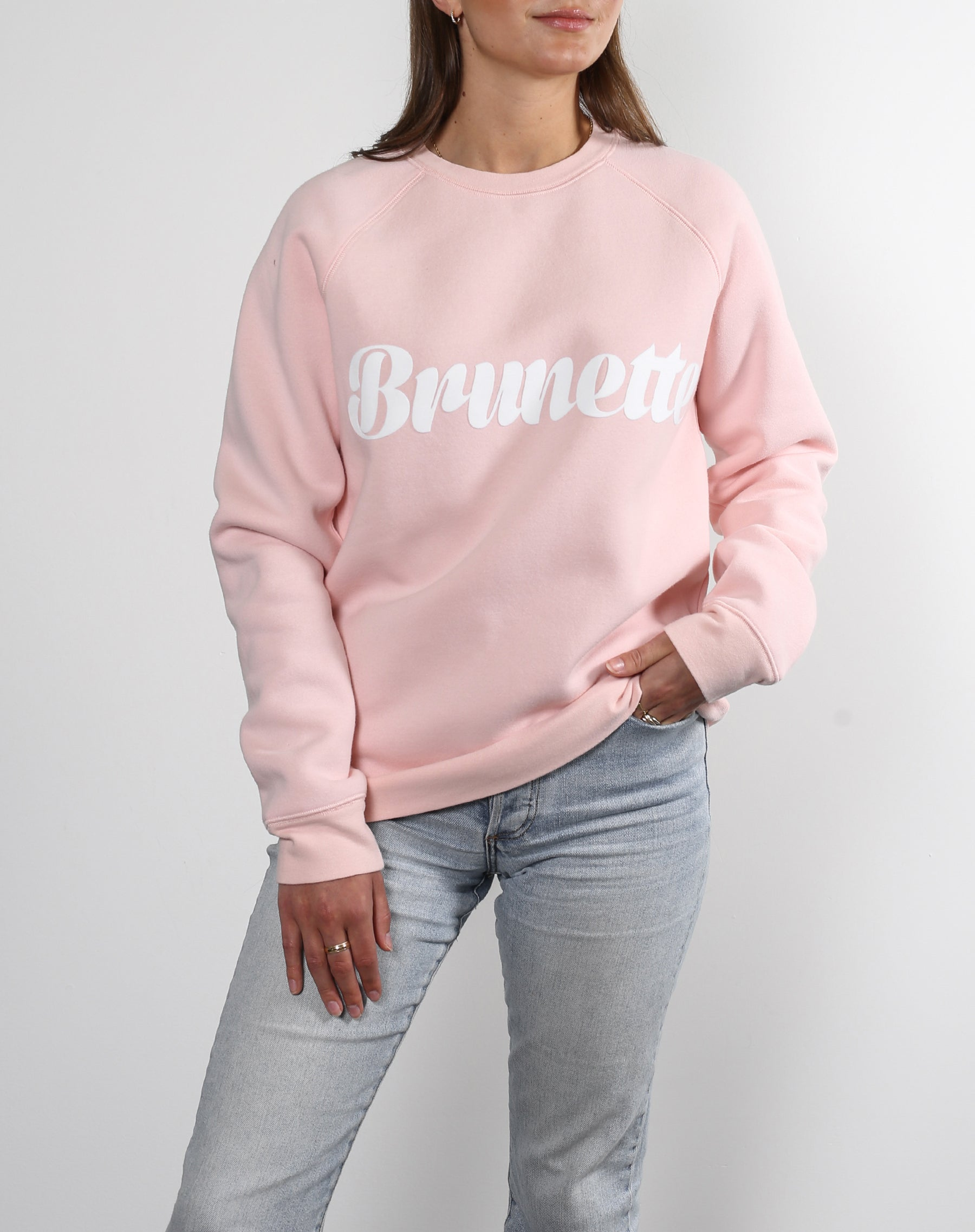 This is an Ecommerce photo of a model wearing the Brunette Cursive Classic Crew in Ballet Slipper by Brunette the Label.