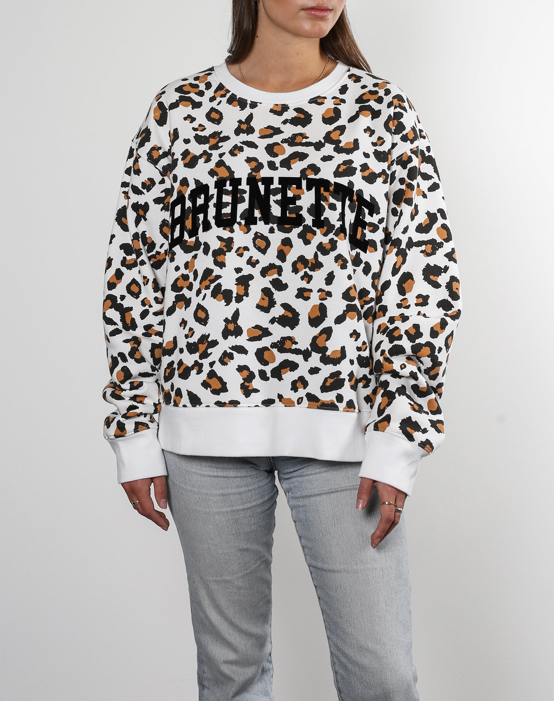 This is a ecommerce photo of the Brunette Step Sister Crew Neck Sweatshirt in White Leopard by Brunette the Label