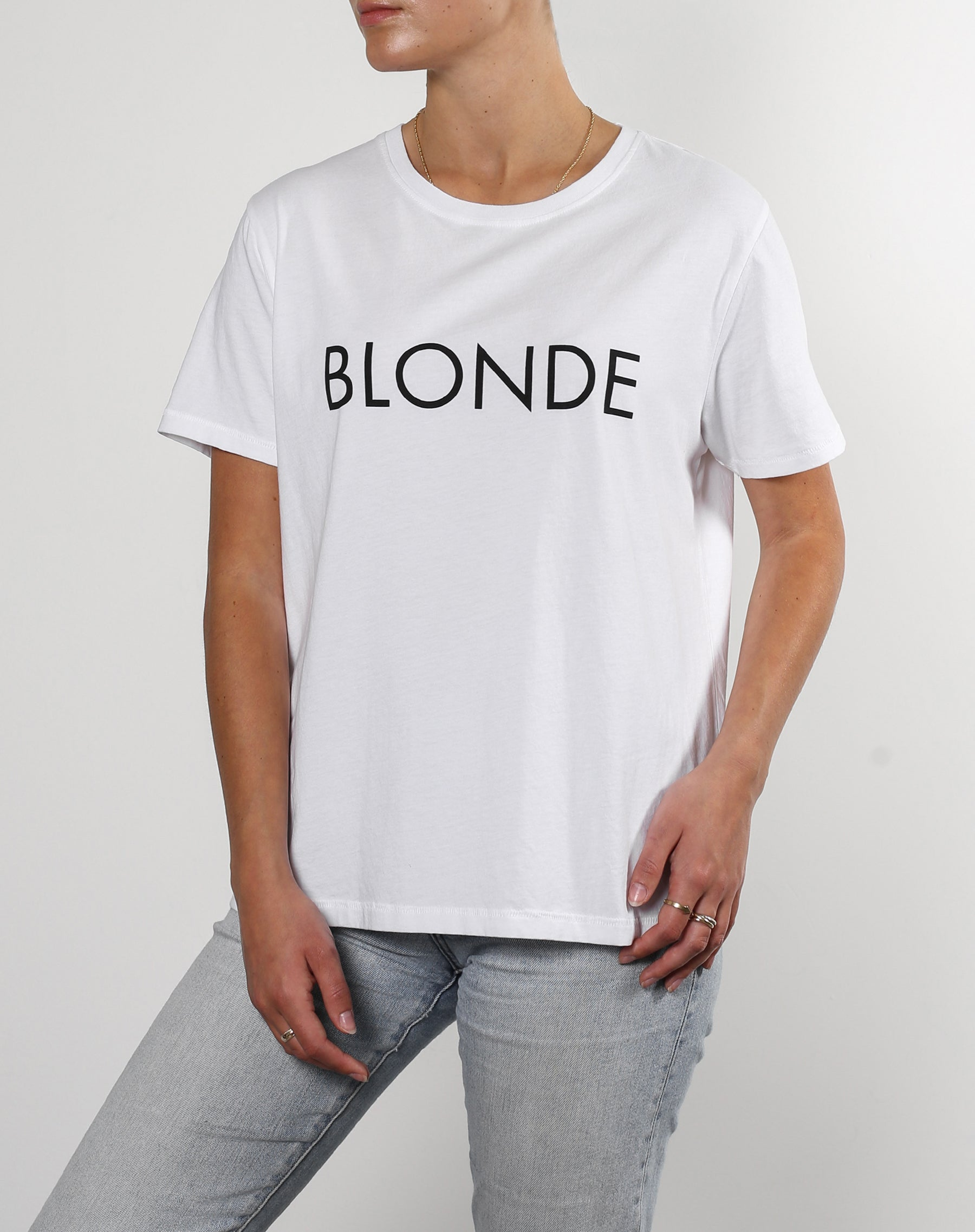 This is a photo of a model wearing the blonde classic crew neck tee in white by brunette the label.
