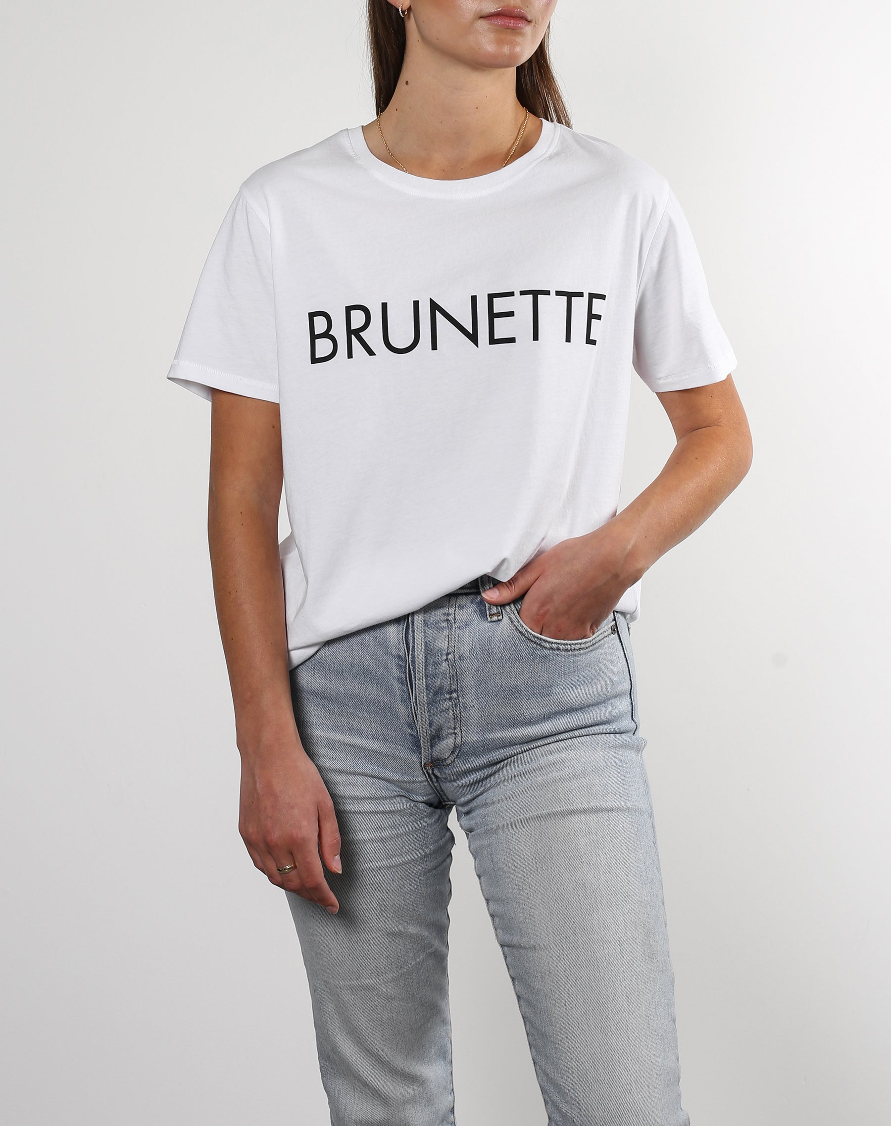 This is a photo of a model wearing the brunette classic crew neck tee in white by brunette the label.