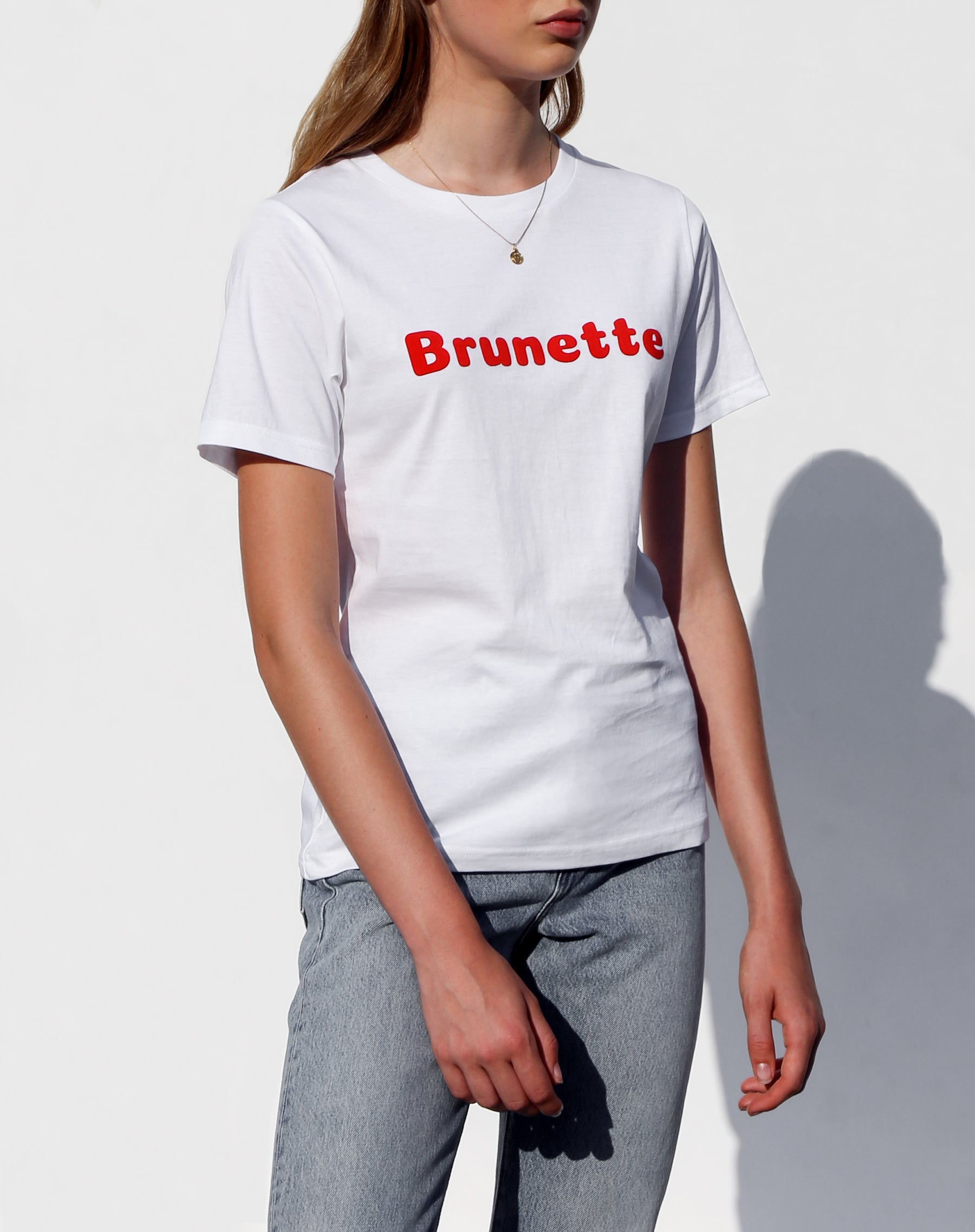 Side photo of the Brunette classic crew neck tee in white for the Canada Day collection by Brunette the Label.