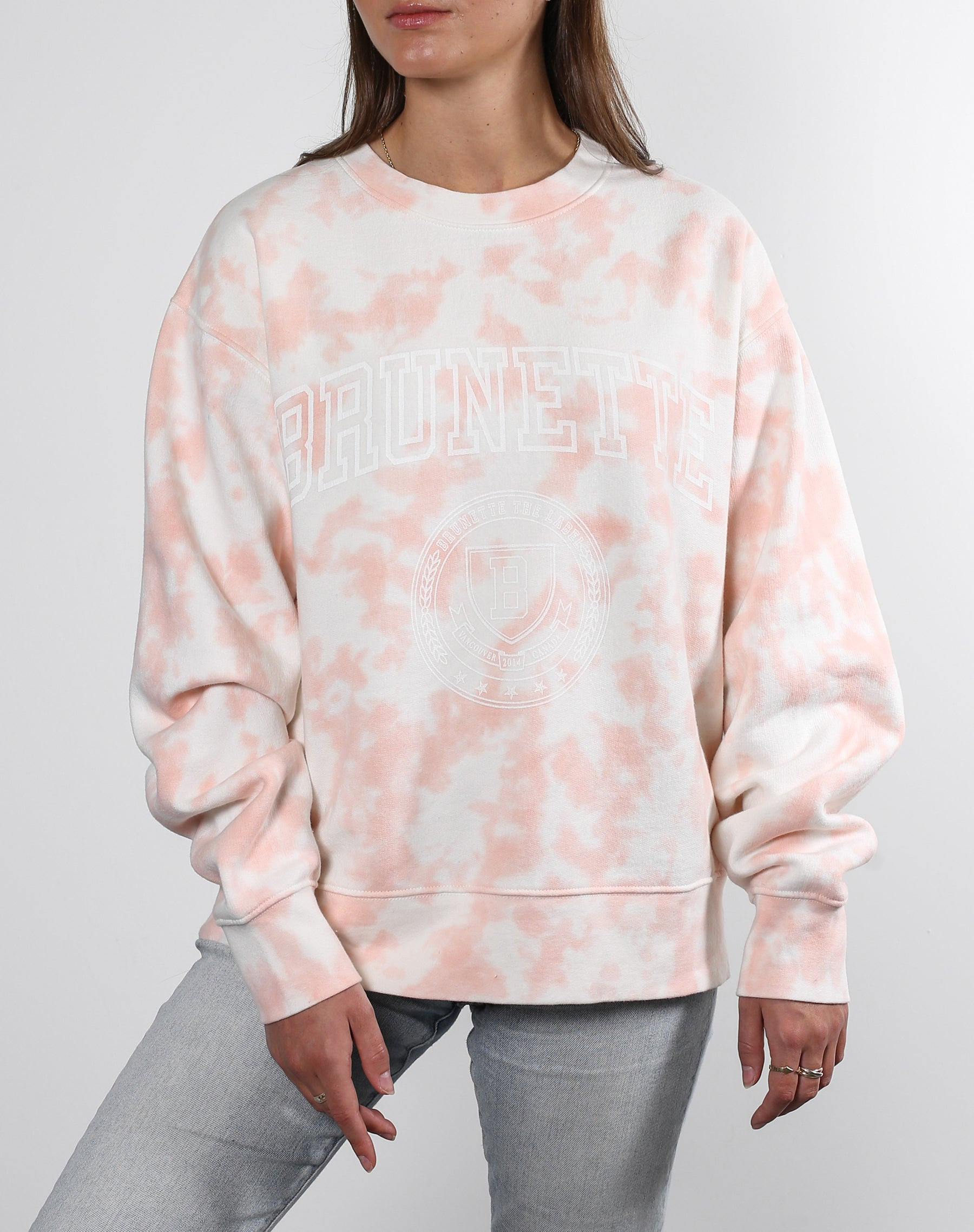 This is an Ecommerce photo of the Brunette Step Sister Crew Neck Sweatshirt in Pink Marble Tie Dye