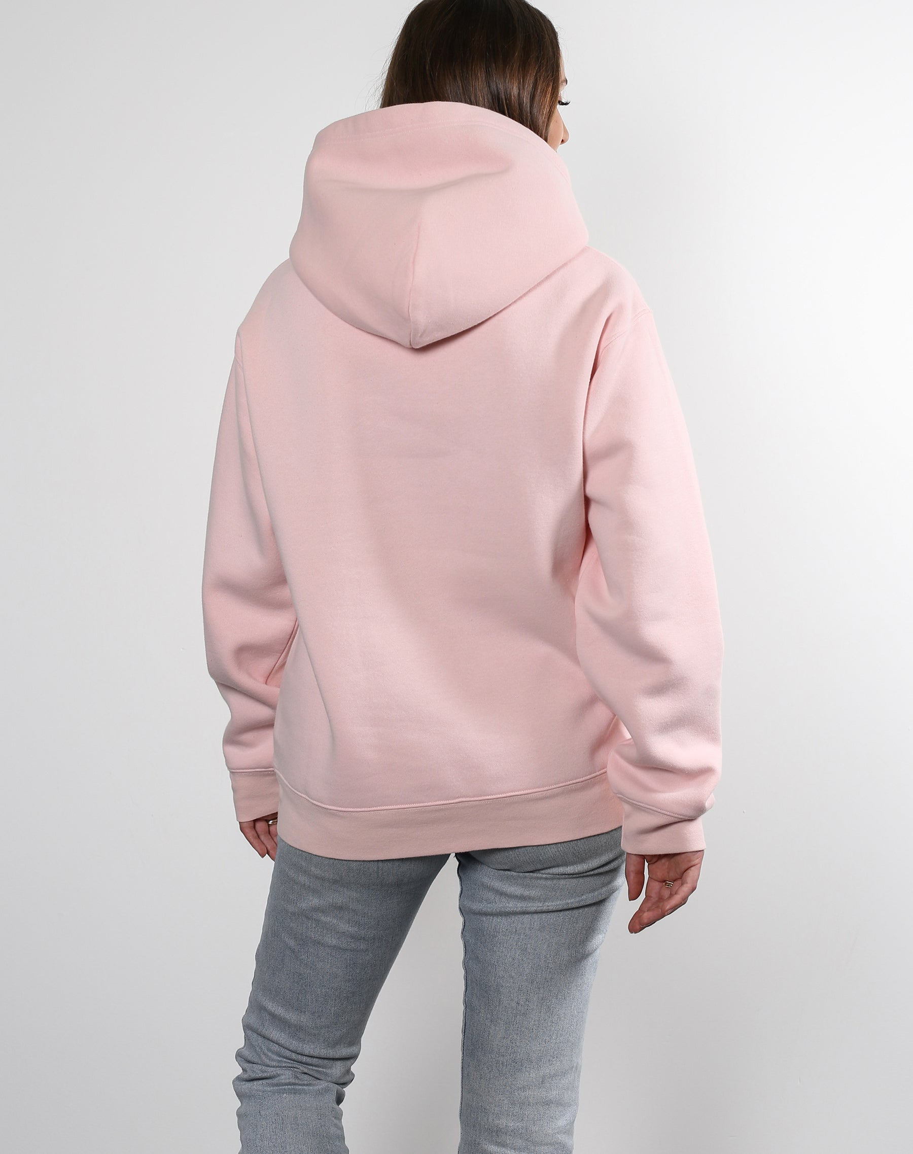 This is an Ecommerce photo of a model wearing the Brunette Classic Hoodie in Ballet Slipper by Brunette the Label
