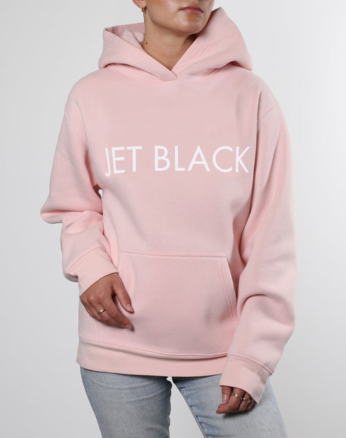 This is an Ecommerce photo of a model wearing the Jet Black Classic Hoodie in Ballet Slipper by Brunette the Label
