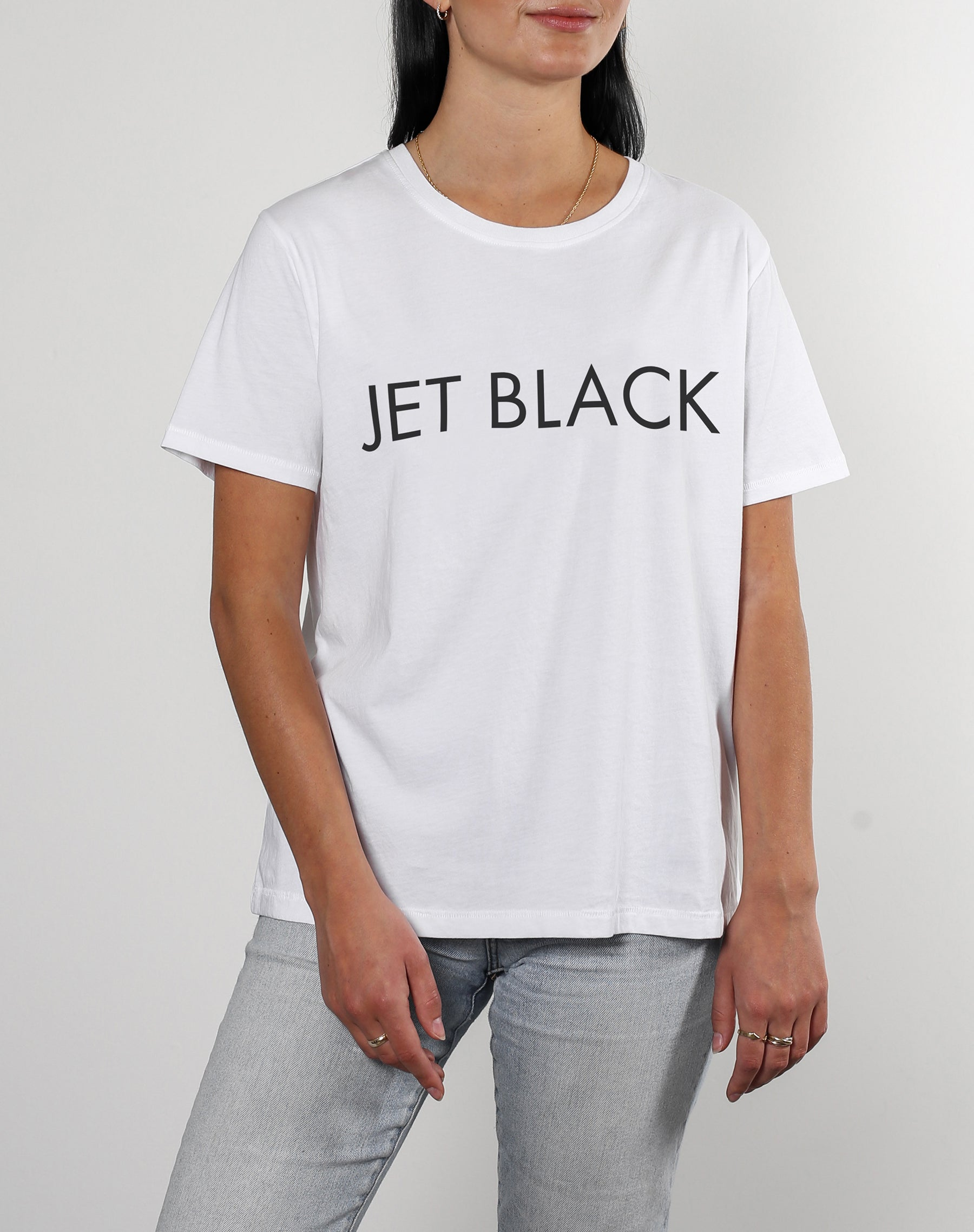 This is a photo of a model wearing Jet Black Classic Crew Neck Tee in White by Brunette The label.