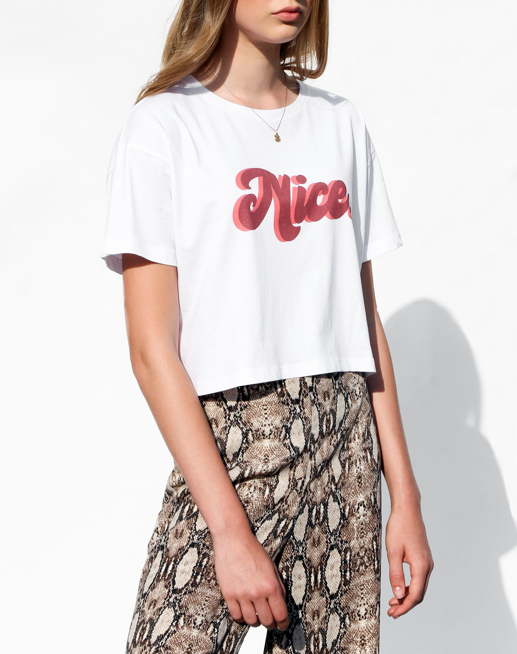 Side photo of the Nice cropped white tee from the Canada Day collection by Brunette the Label.