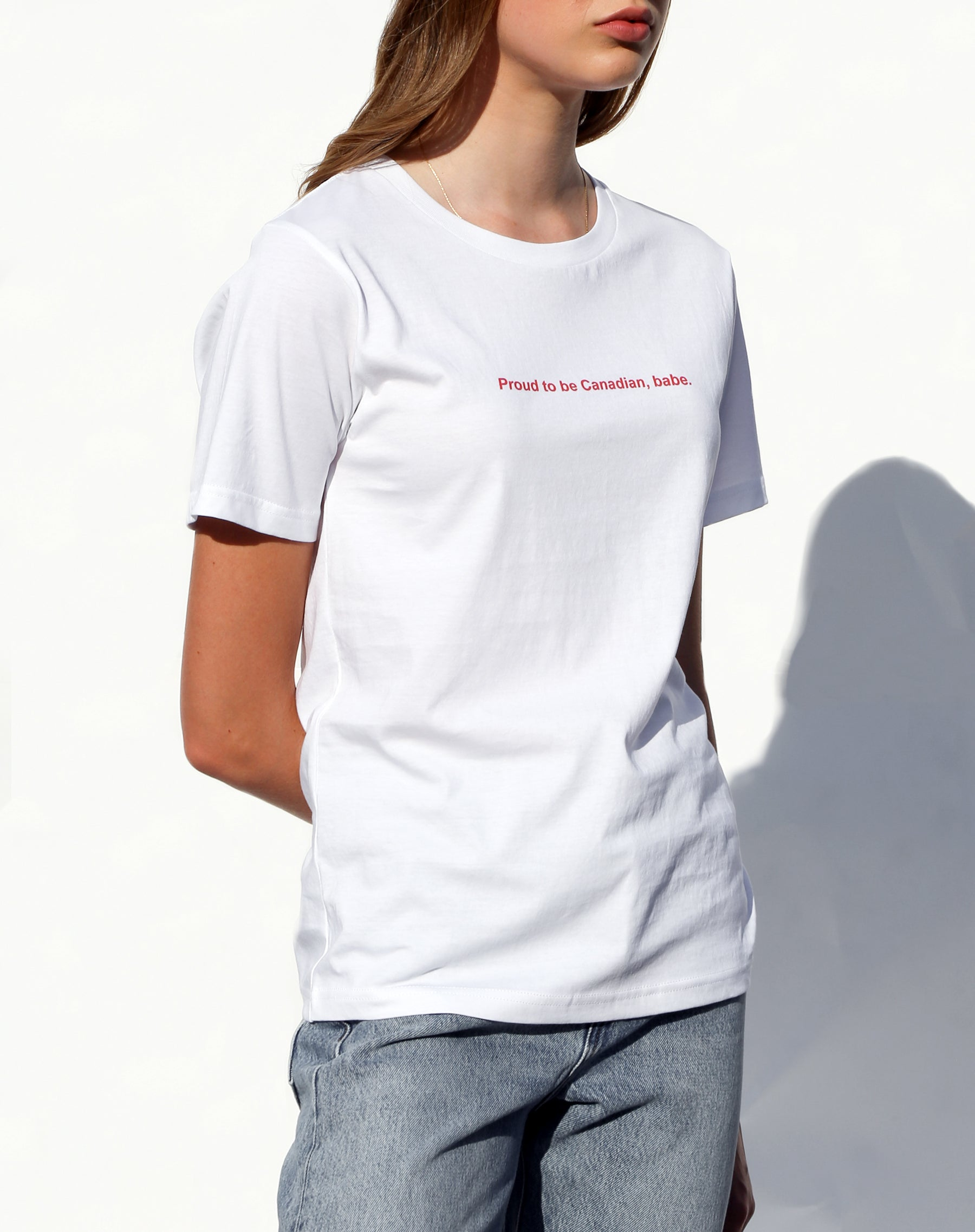 Side photo of the Proud to be Canadian classic crew neck tee in white from the Canada Day collection by Brunette the Label.