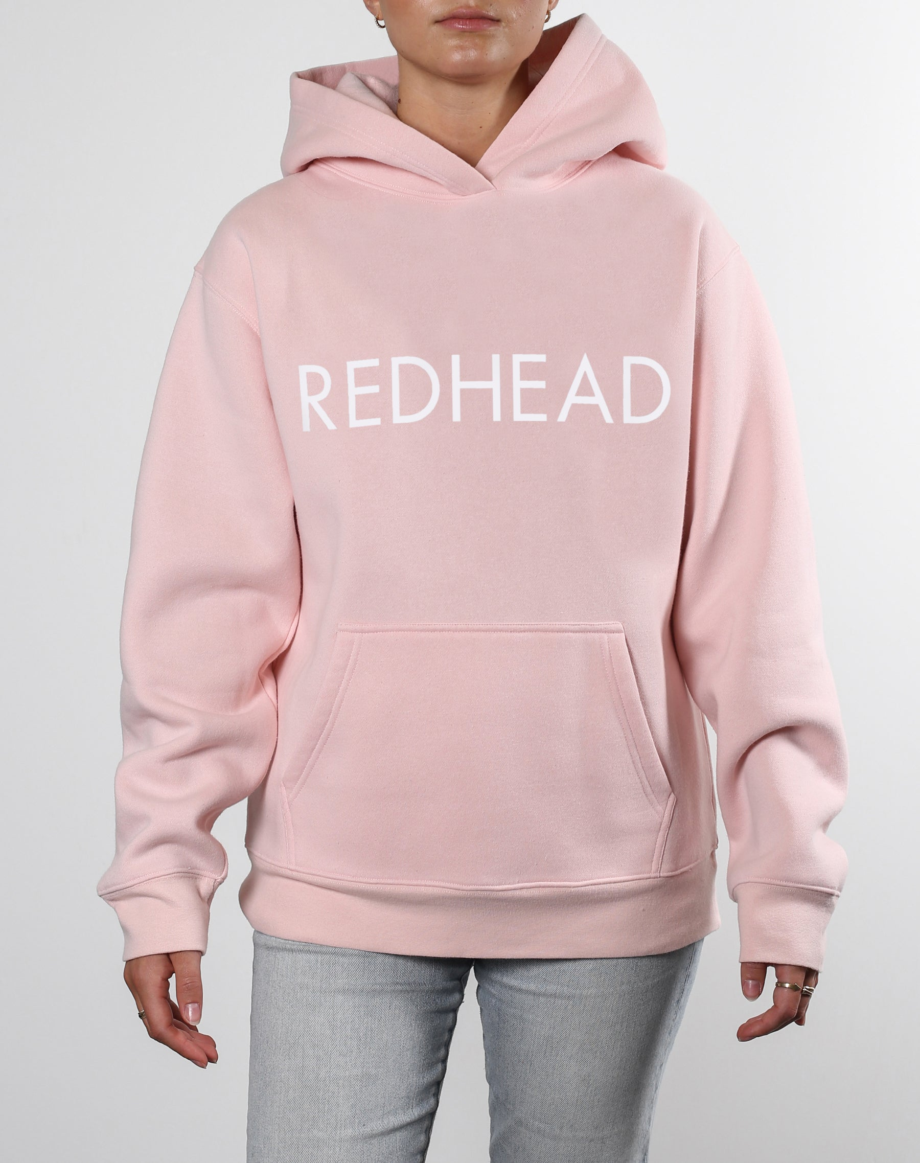 This is an Ecommerce photo of a model wearing the  RedHead Classic Hoodie in Ballet Slipper by Brunette the Label