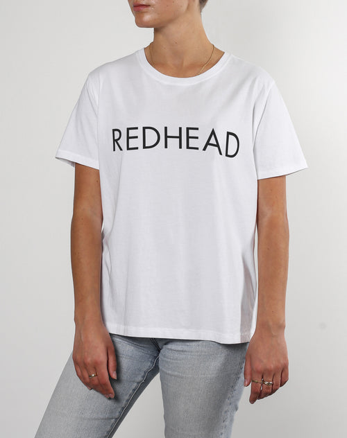 This is a photo of a model wearing the Redhead Classic Crew Neck Tee in White by Brunette The label.