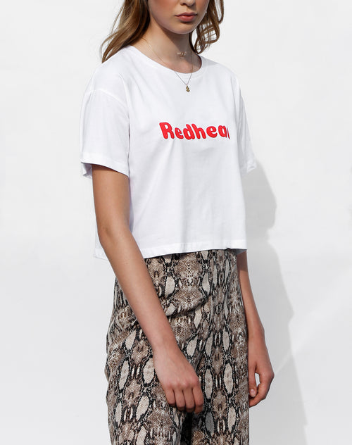 Side photo of the Redhead cropped crew neck tee in white for the Canada Day collection by Brunette the Label.