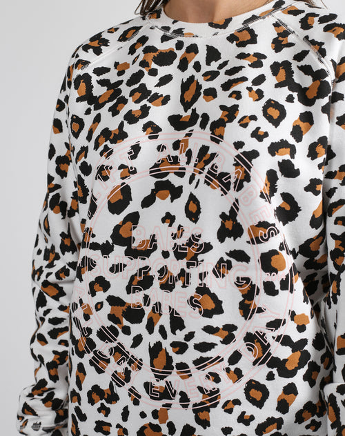 This is a Ecommerce photo of the Uplift All Babes Big Sister Crew Neck Sweatshirt in White Leopard by Brunette the Label