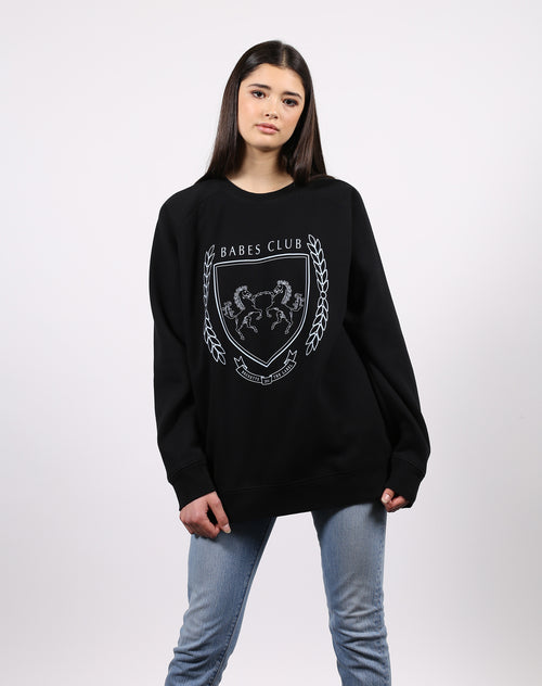 This is an image of the varsity crest big sister crew neck sweatshirt in black from Brunette the Label