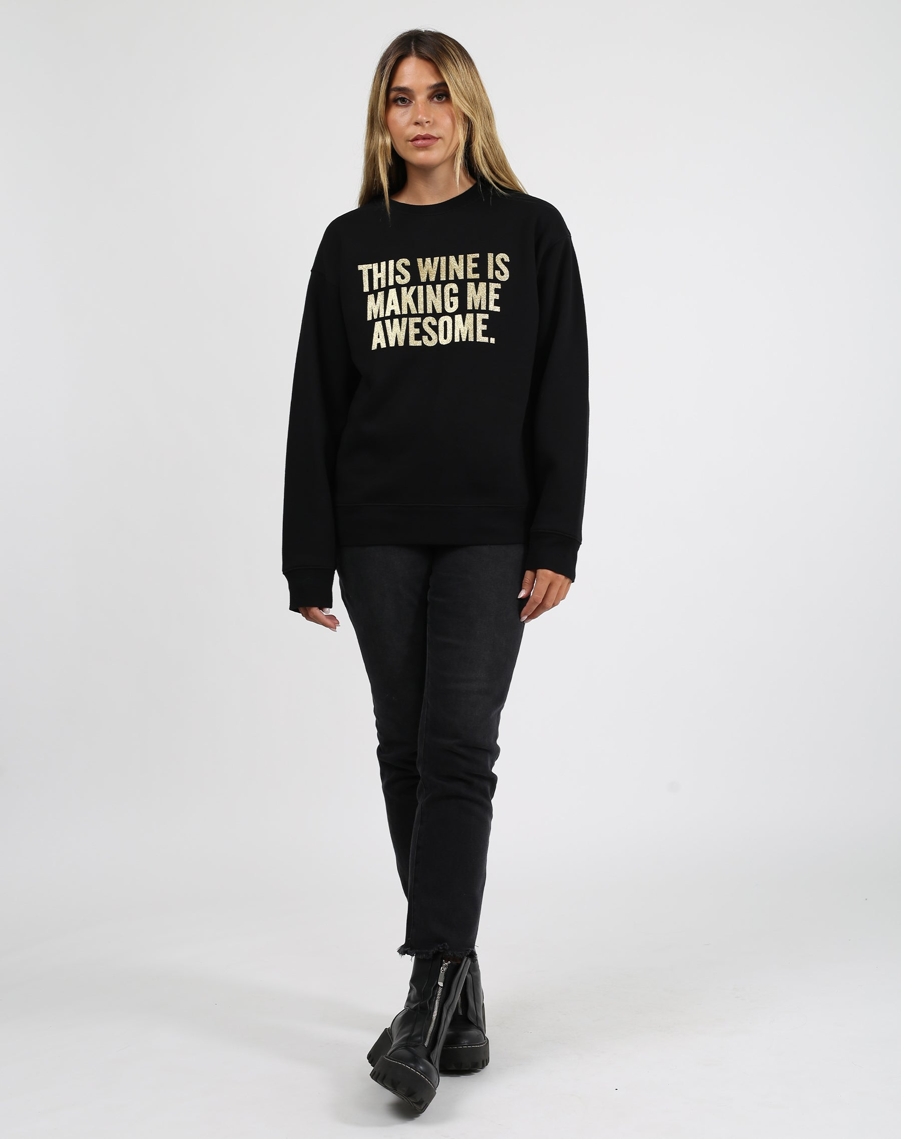 This is a photo of a model wearing the This Wine Gold Glitter Classic Crew Neck Sweatshirt in Black by Brunette the Label.