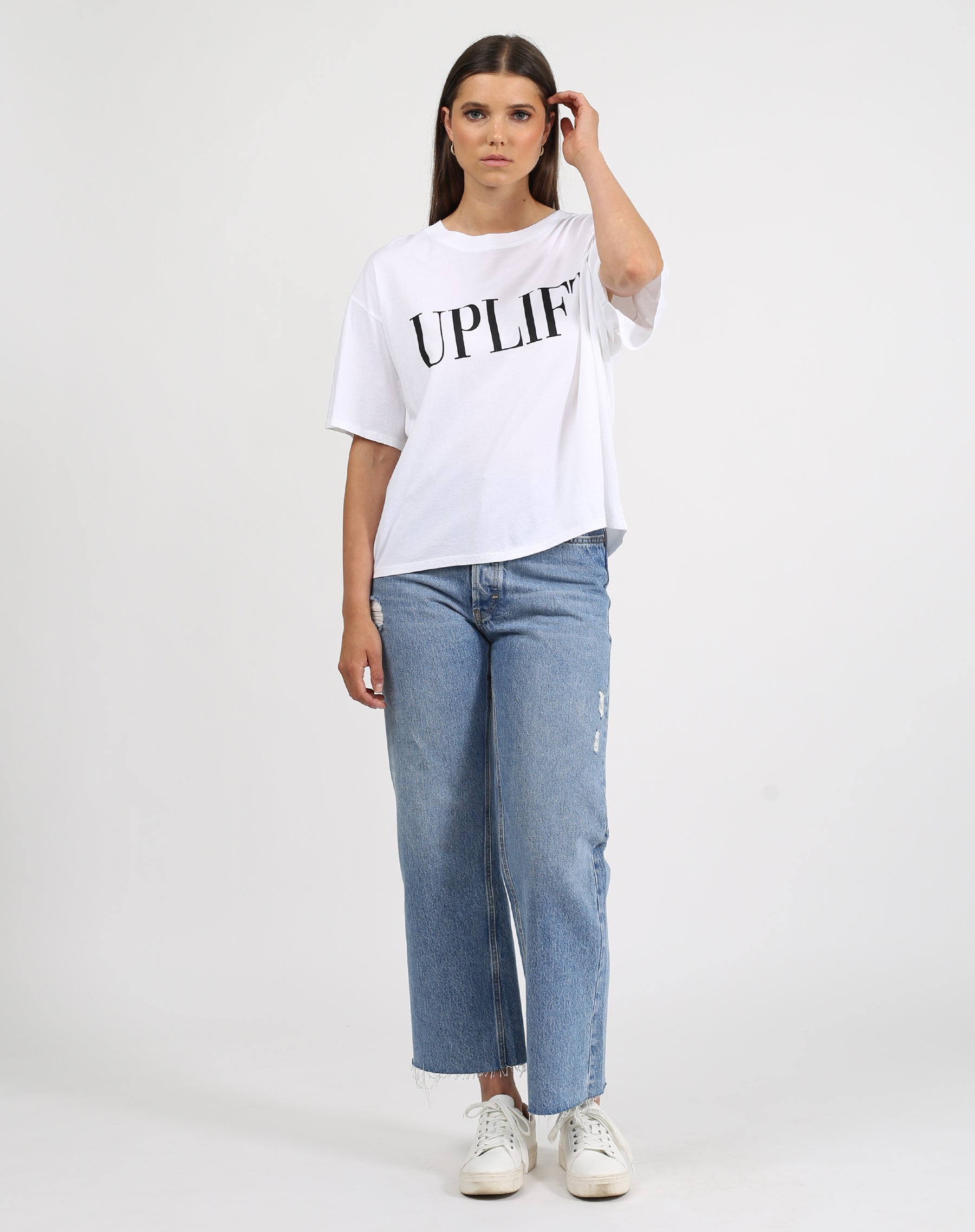This is a photo of a model wearing the uplift boxy tee crew neck in white by brunette the label.