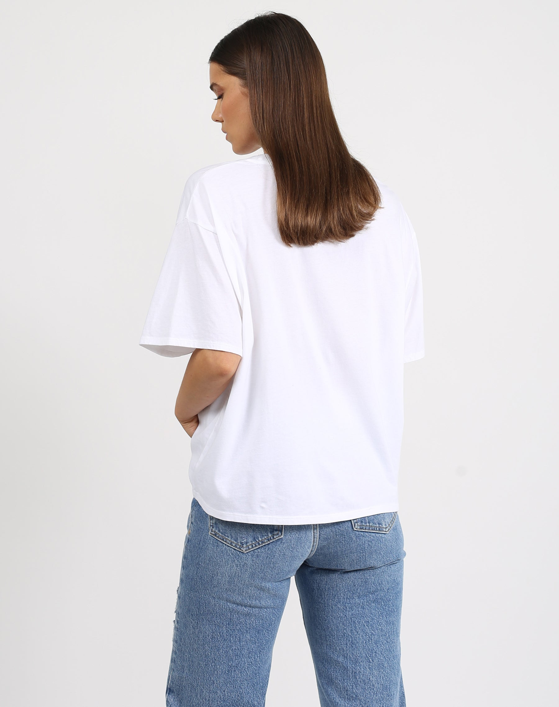 This is a photo of the back of a model wearing the uplift boxy tee crew neck in white by brunette the label.