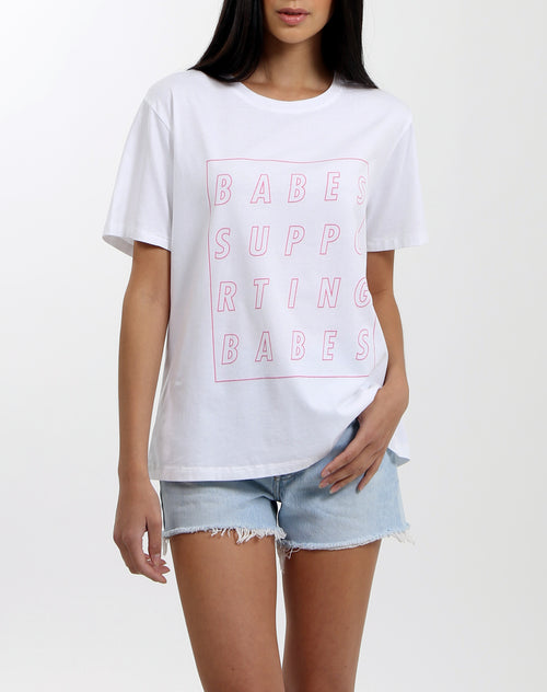 Photo 2 of the Babes Supporting Babes Cube crew neck tee for the vision program in white by Brunette the Label.