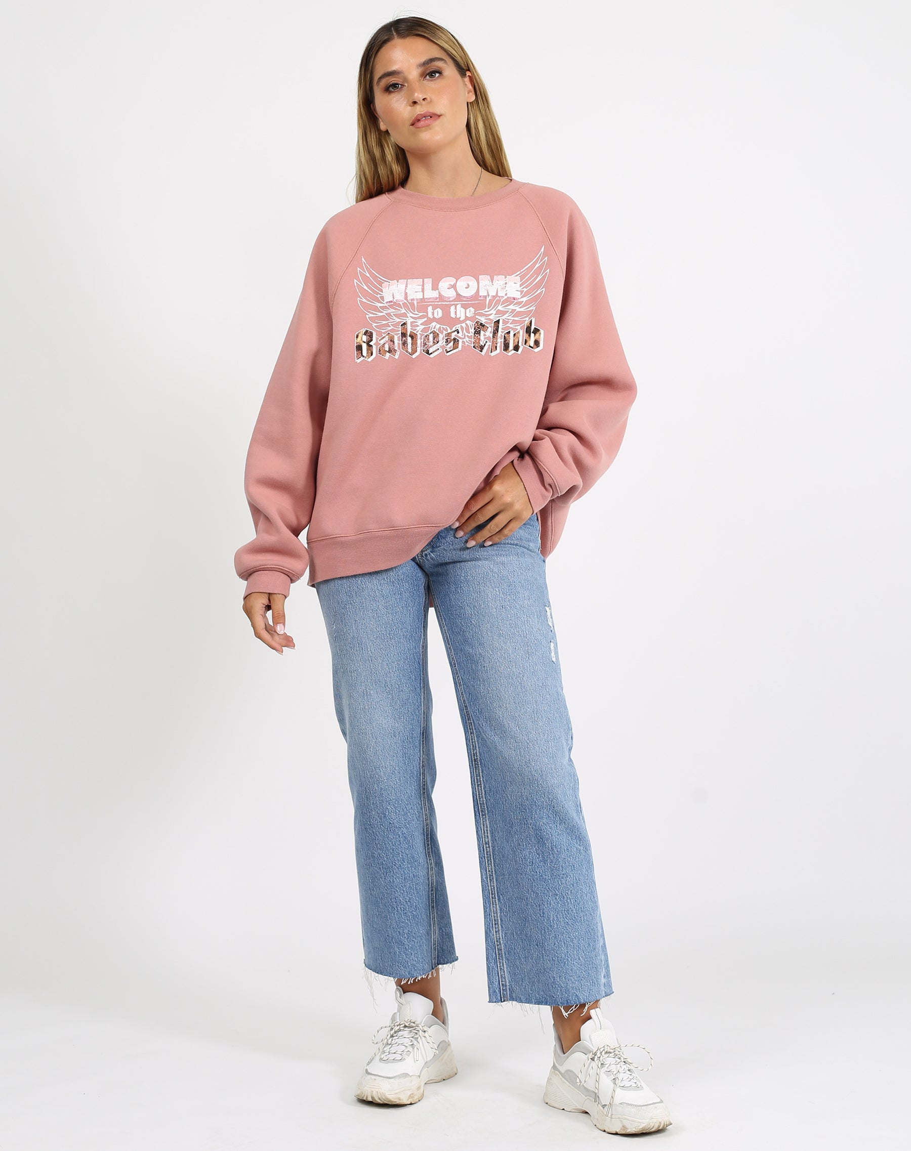 This is a photo of a model wearing the welcome to the babes club not your boyfriend fit crew neck sweatshirt in vintage rose by brunette the label.