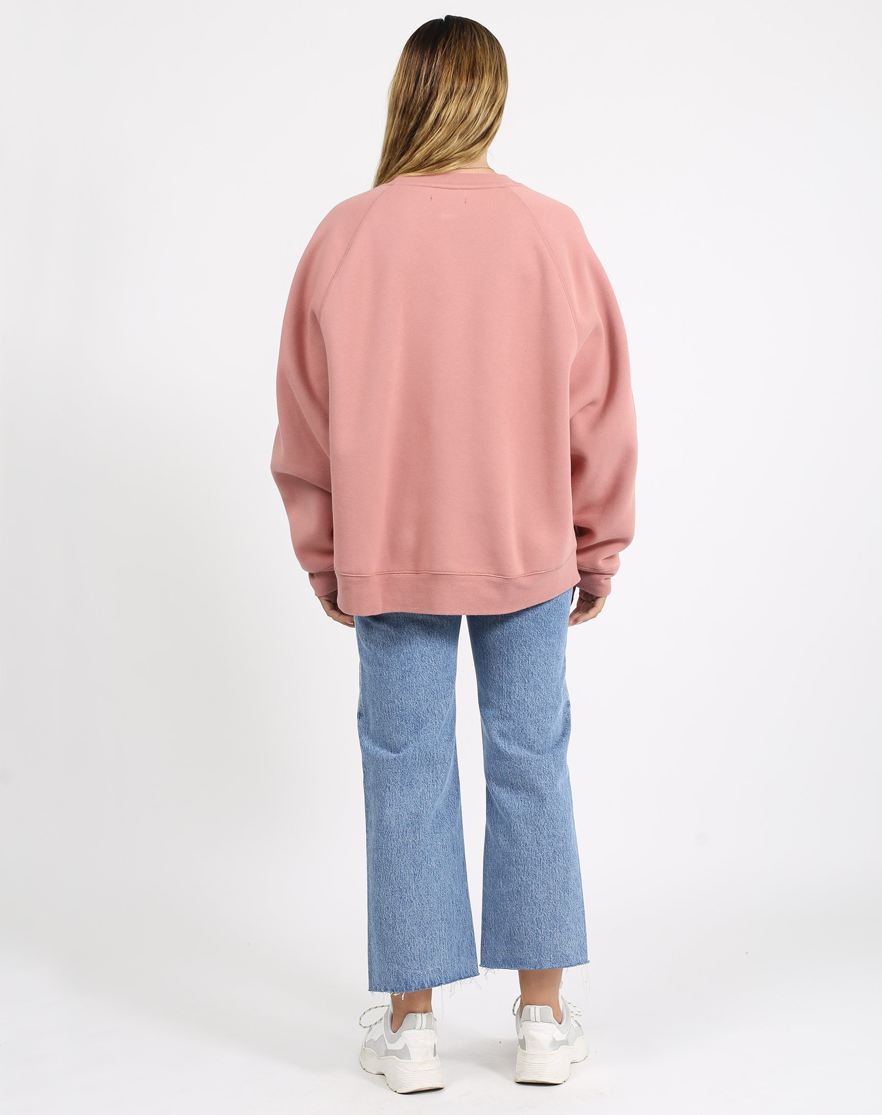 This is a photo of the back of a model wearing the welcome to the babes club not your boyfriend fit crew neck sweatshirt in vintage rose by brunette the label.