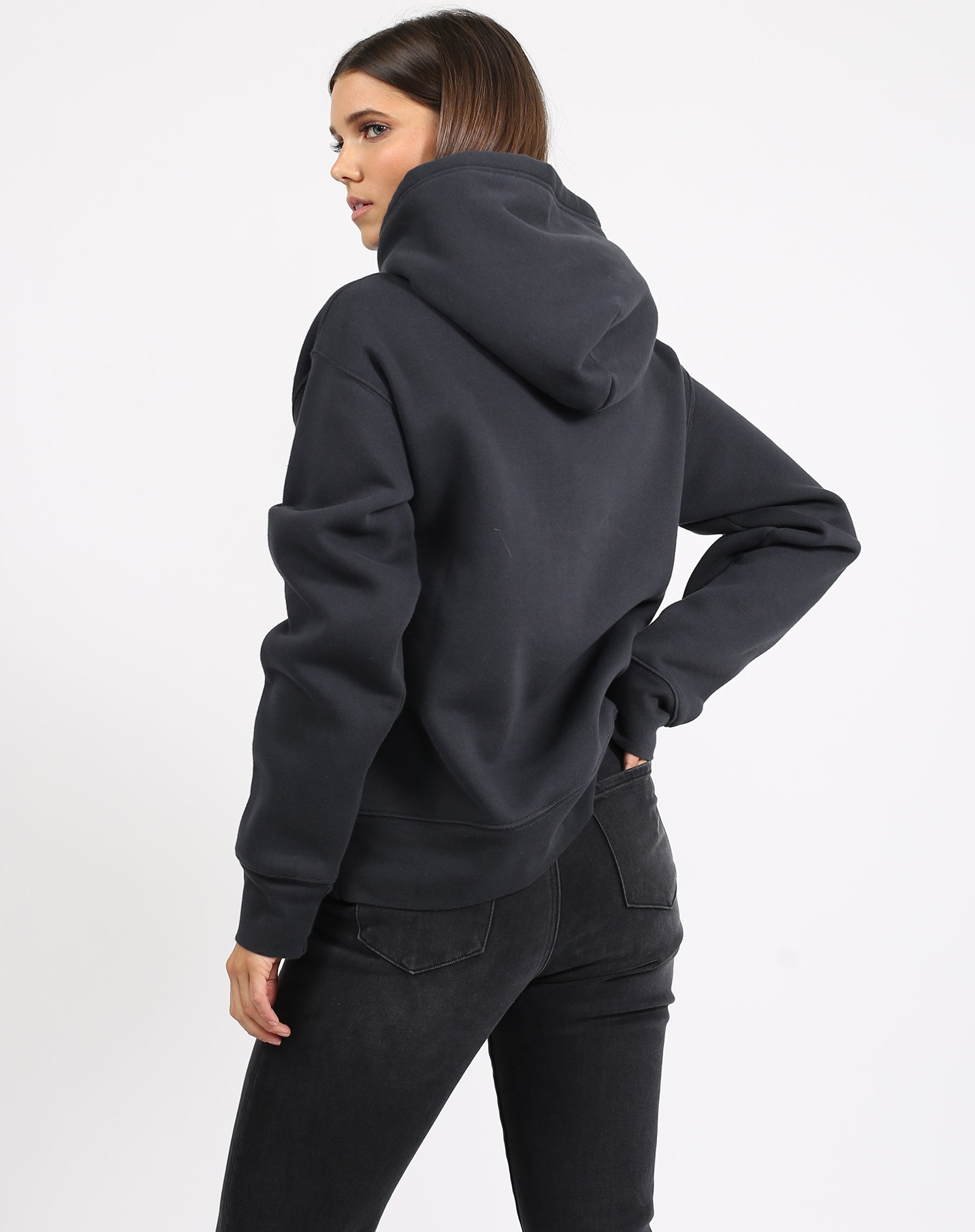 This is a photo of a model wearing the welcome to the babes club step sister hoodie in charcoal by brunette the label.