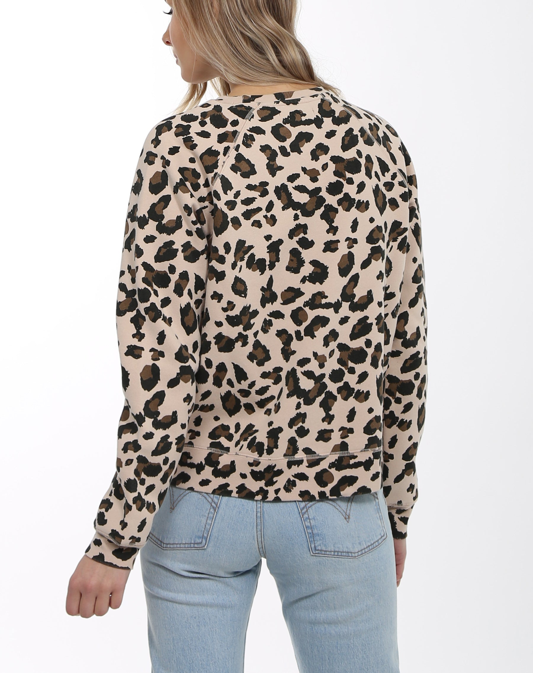 Photo of the back of the Redhead middle sister crew neck sweatshirt in leopard print by Brunette the Label.