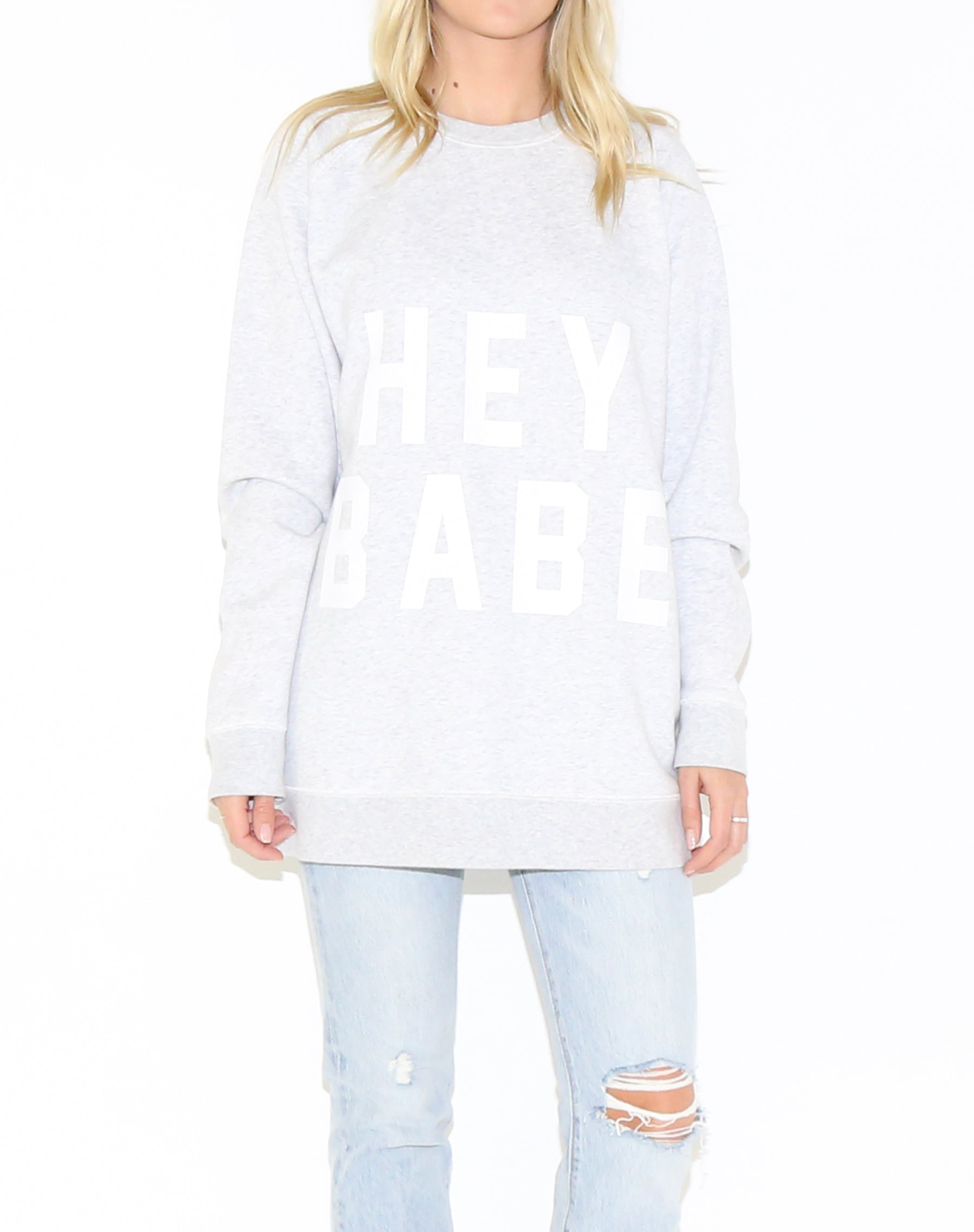 Photo 2 of the Hey Babe big sister crew neck sweatshirt in pebble grey by Brunette the Label.