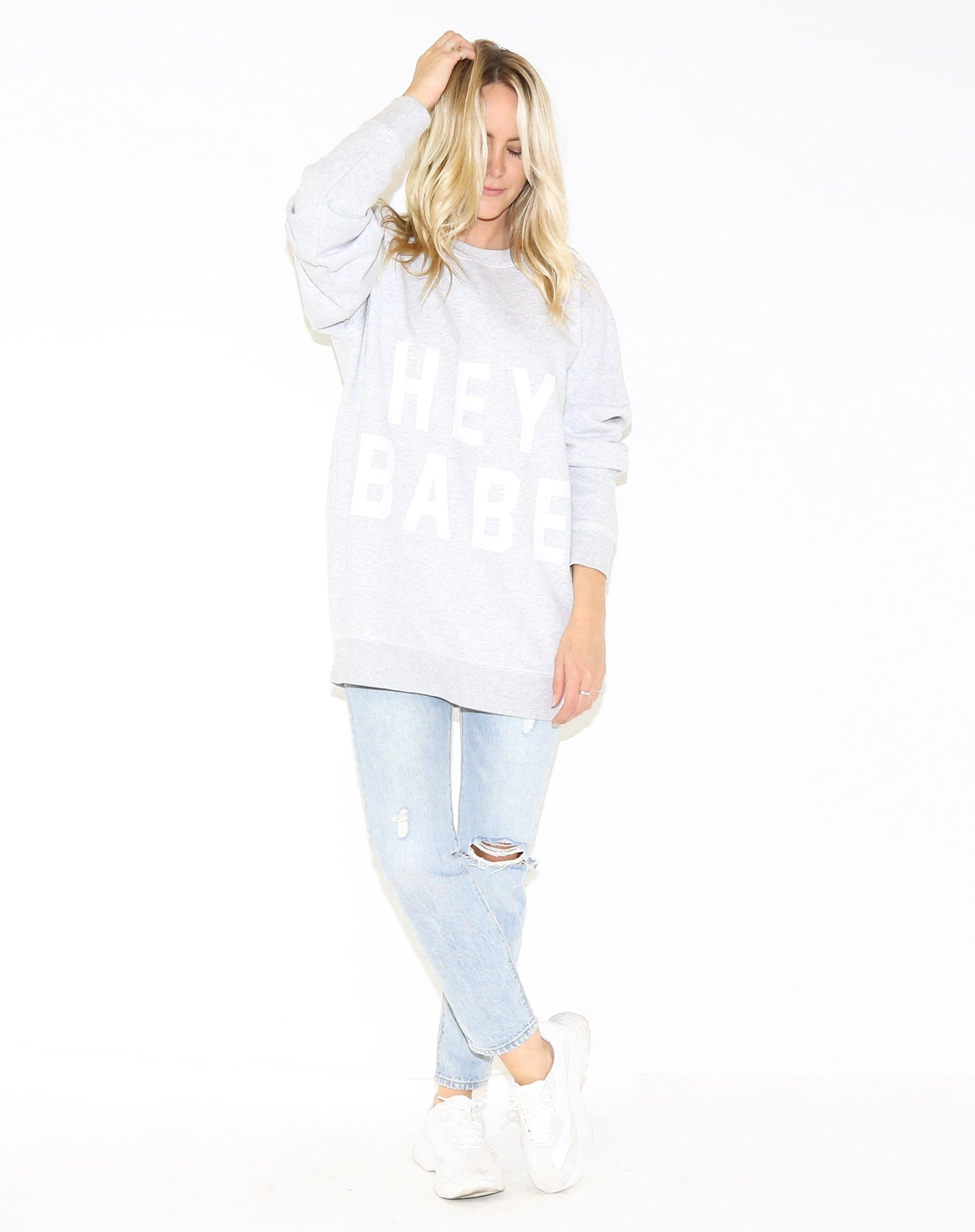 Photo 3 of the Hey Babe big sister crew neck sweatshirt in pebble grey by Brunette the Label.