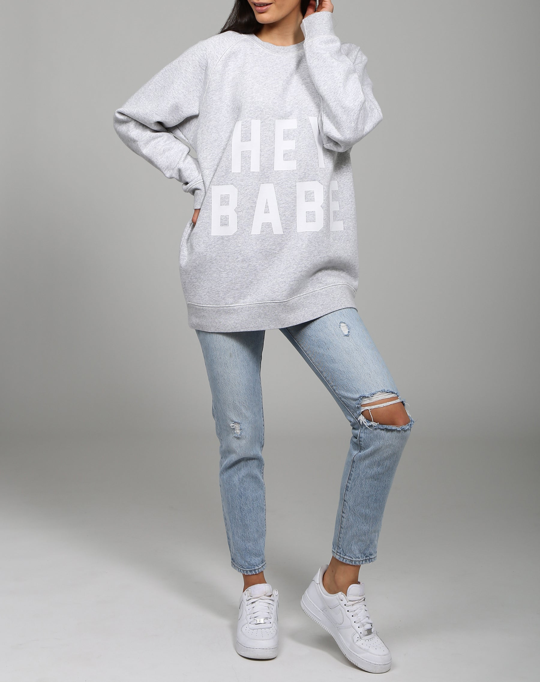 Photo of the Hey Babe big sister crew neck sweatshirt in pebble grey by Brunette the Label.