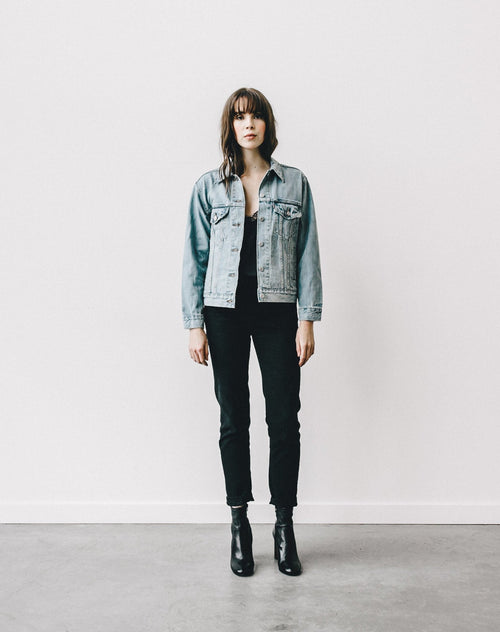 Full body photo of the Blonde Lindsay denim jacket by Brunette the Label.
