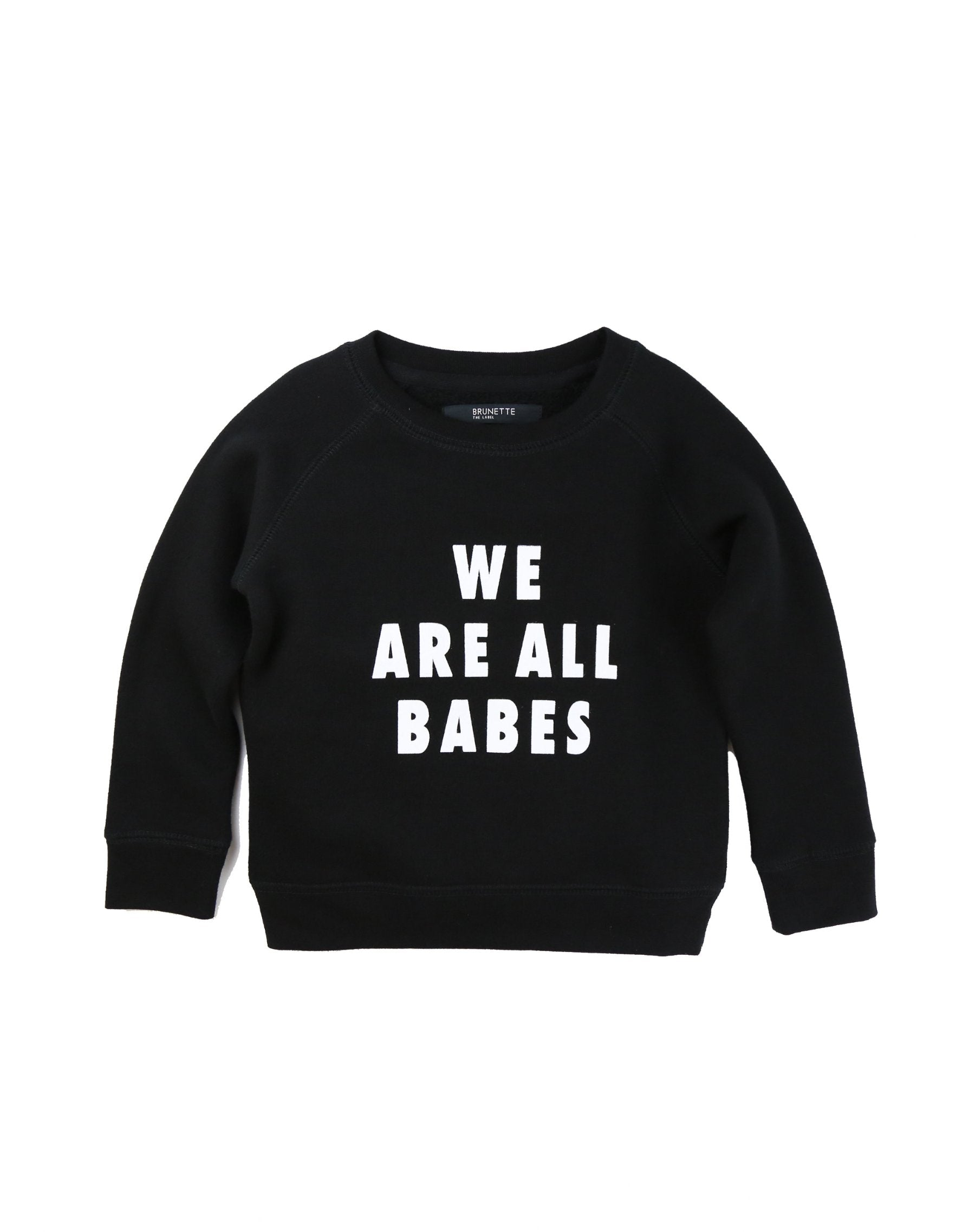 Photo of the We Are All Babes Little Babes classic crew neck sweatshirt in black by Brunette the Label.