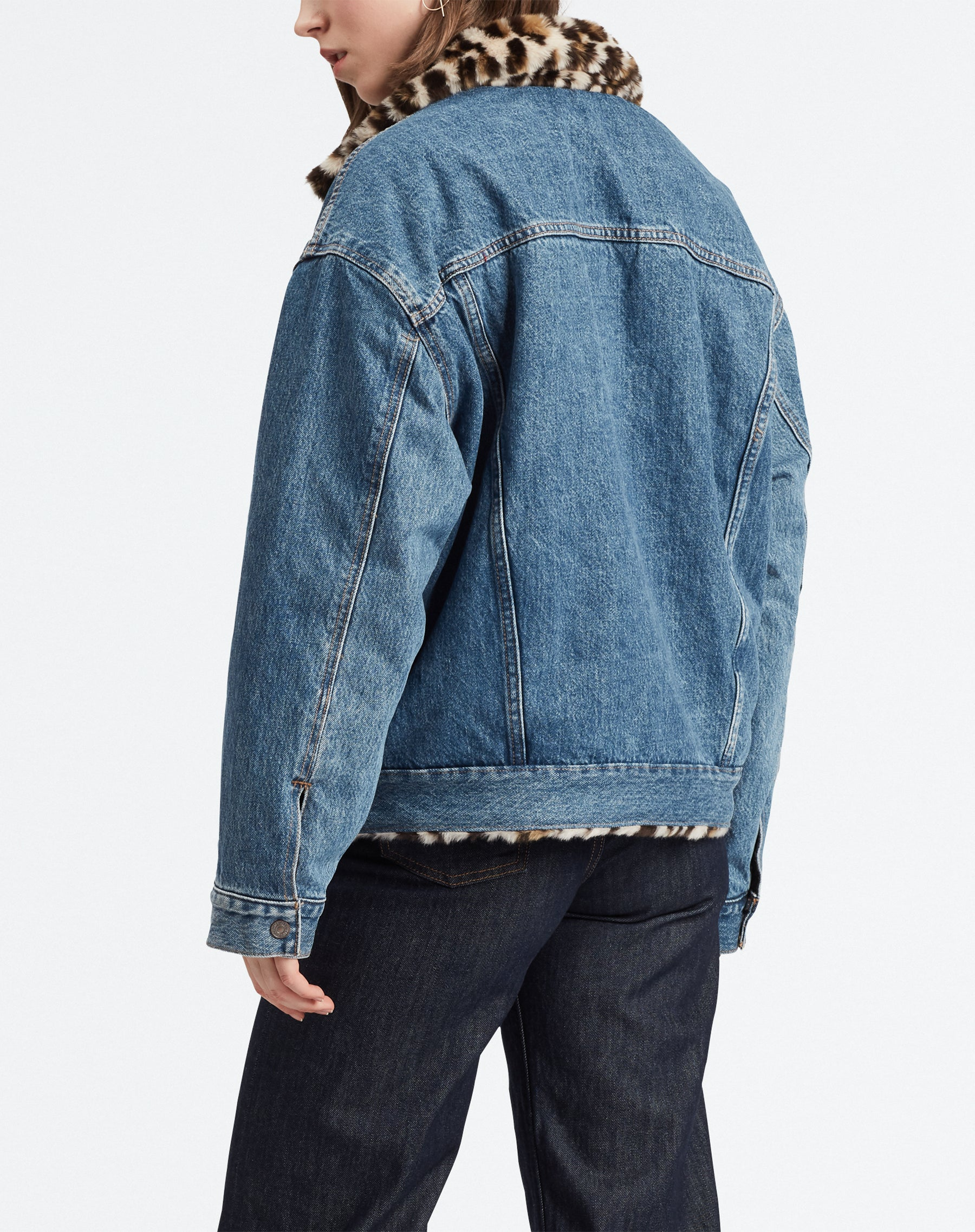 Photo of the back of the  Cat Eye denim reversible jacket in medium wash by Levi.