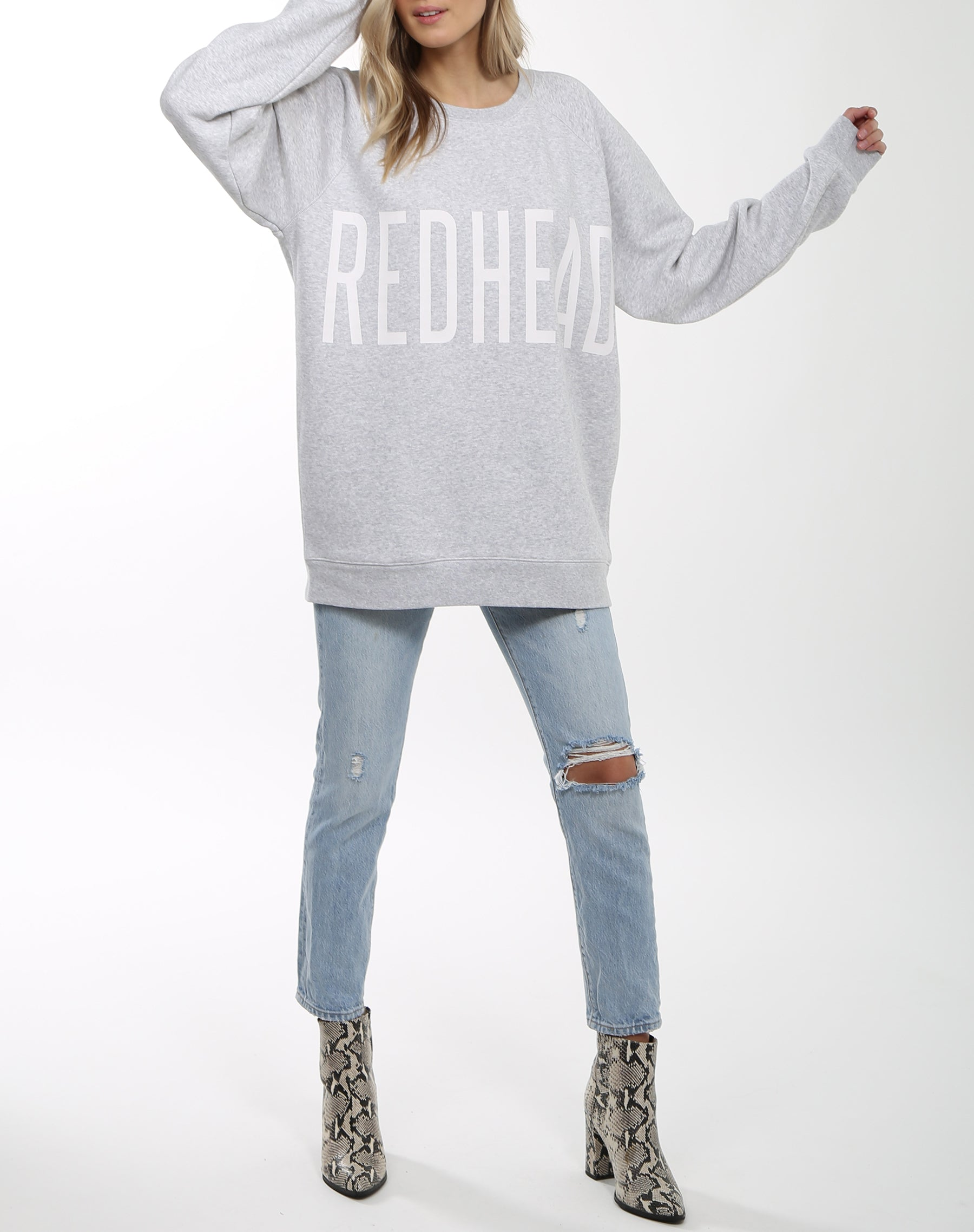 Photo 2 of the Redhead big sister crew neck sweatshirt in pebble grey by Brunette the Label.