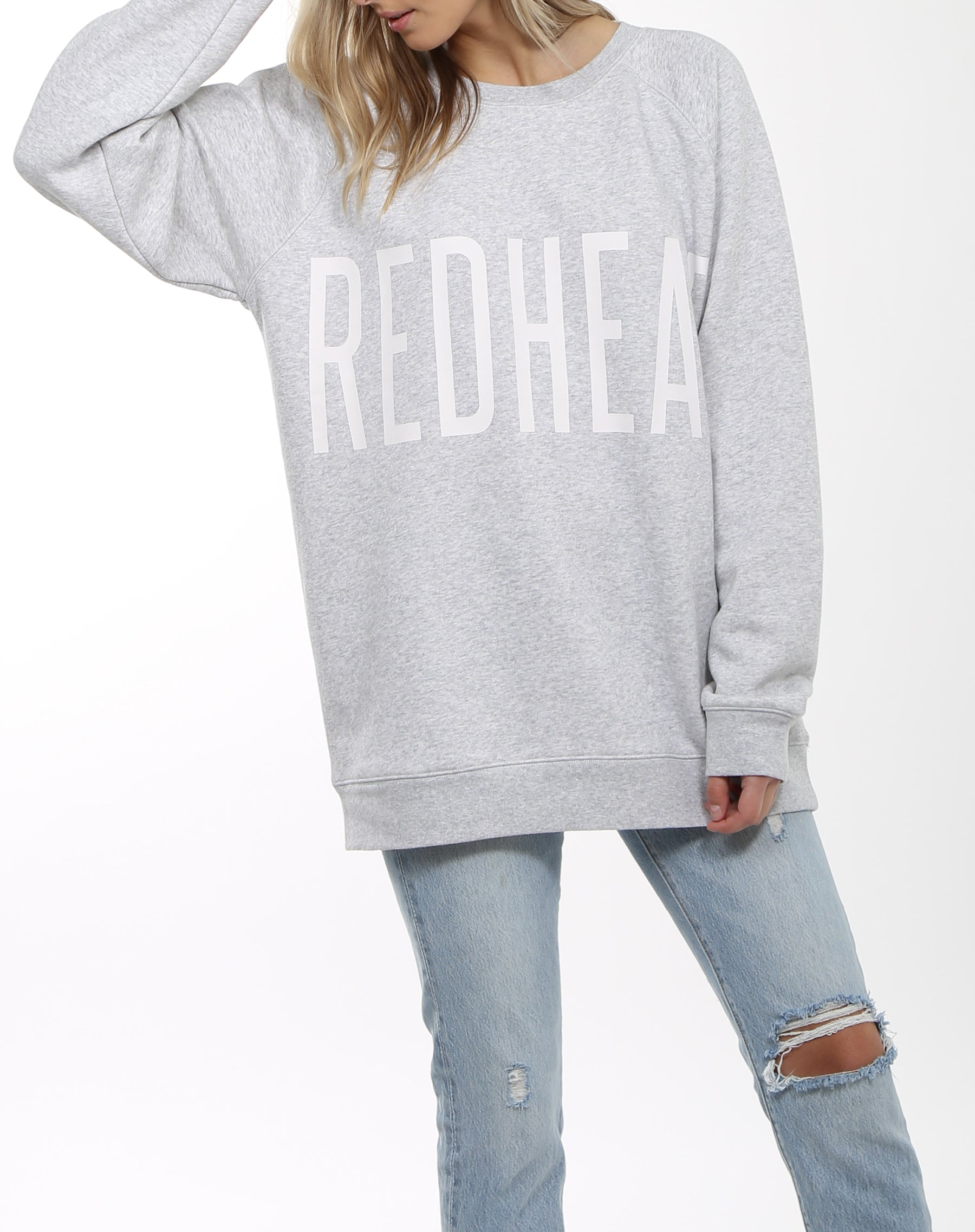 Photo of the Redhead big sister crew neck sweatshirt in pebble grey by Brunette the Label.