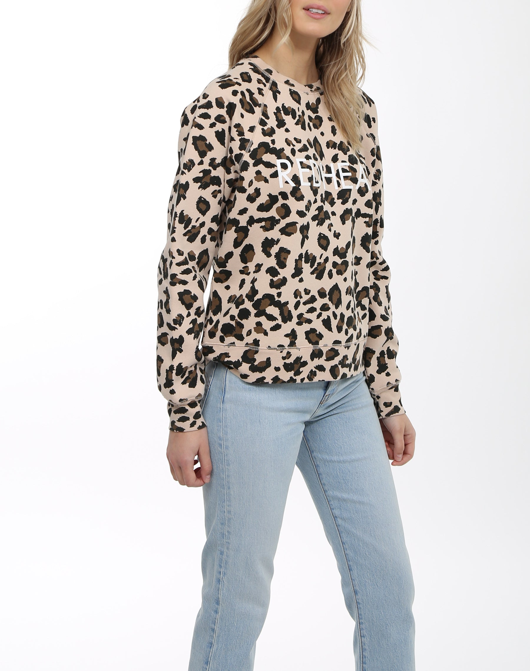 Photo of the side of the Redhead middle sister crew neck sweatshirt in leopard print by Brunette the Label.
