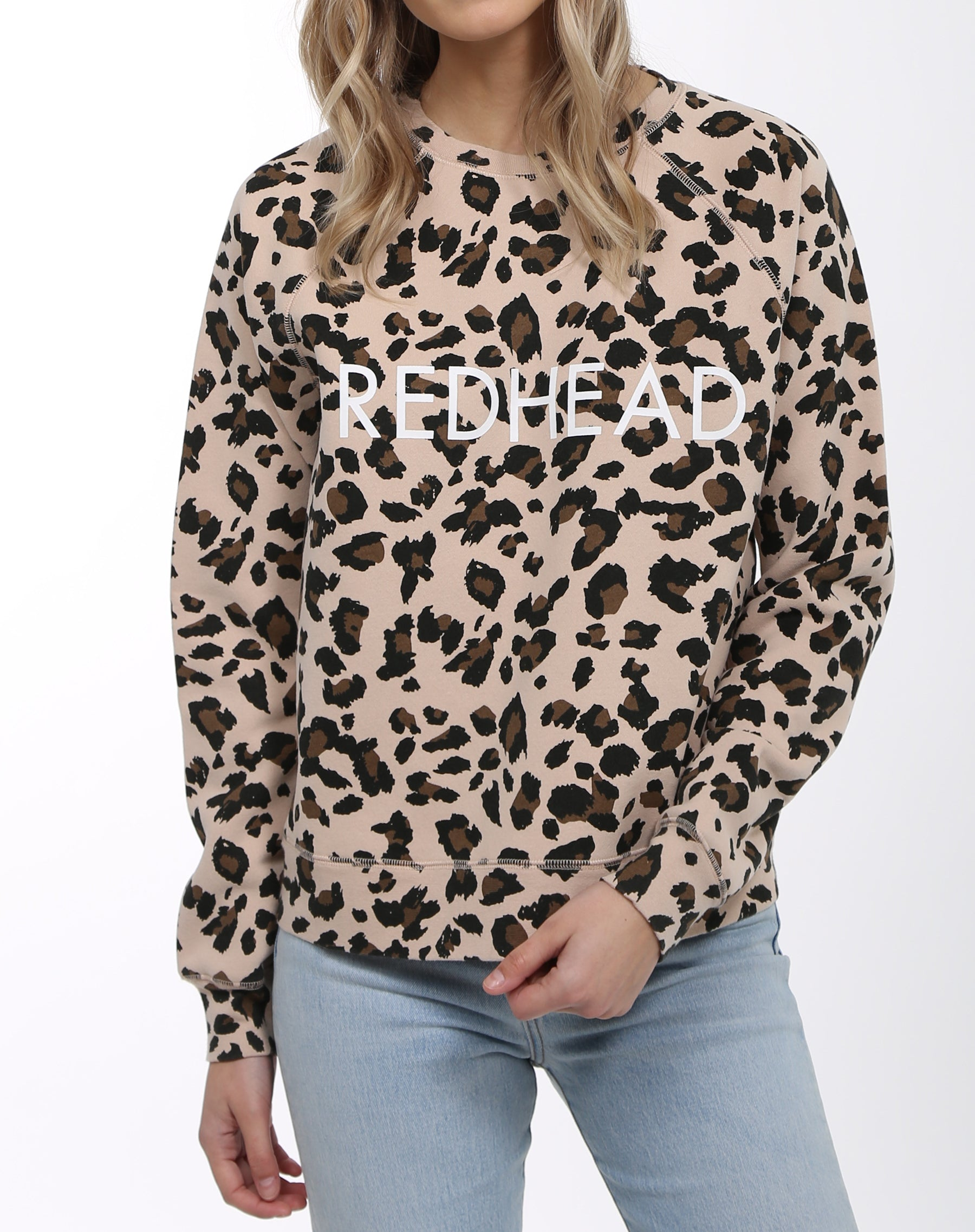 Photo of the Redhead middle sister crew neck sweatshirt in leopard print by Brunette the Label.