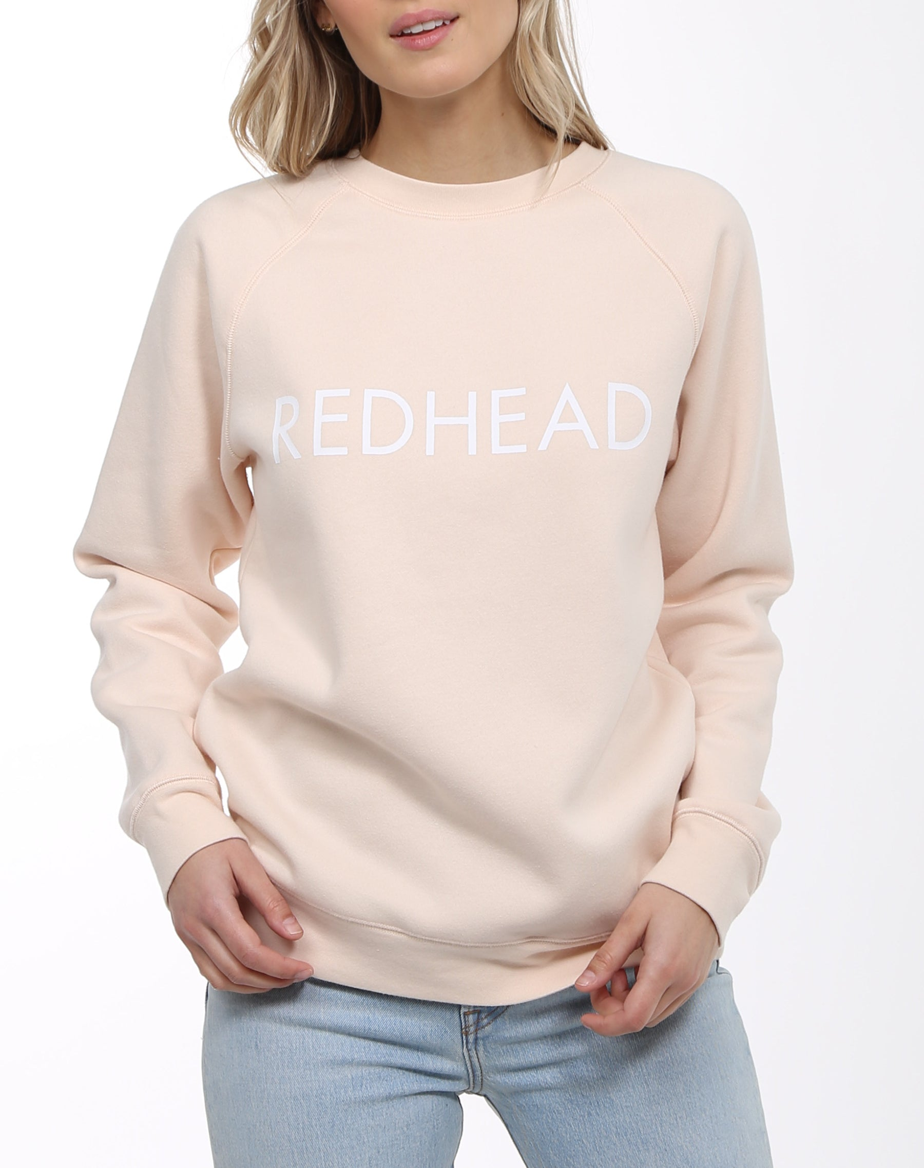 Photo 2 of the Redhead classic crew neck sweatshirt in peach crush by brunette the label.