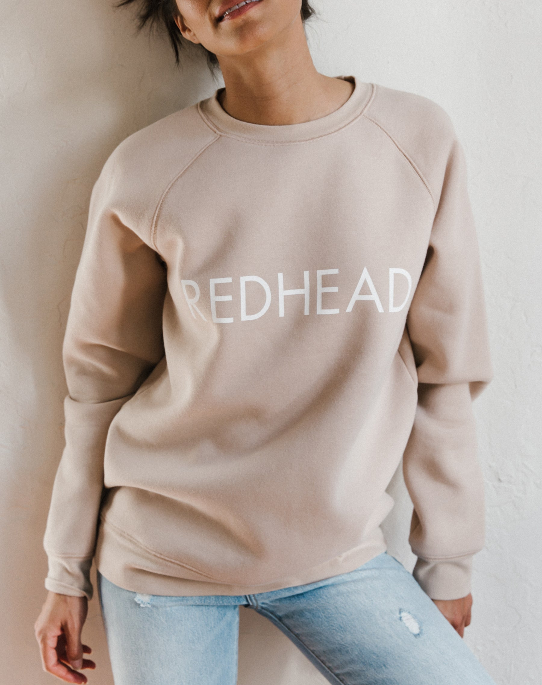 Photo of the Redhead classic crew neck sweatshirt in toasted almond by Brunette the label.