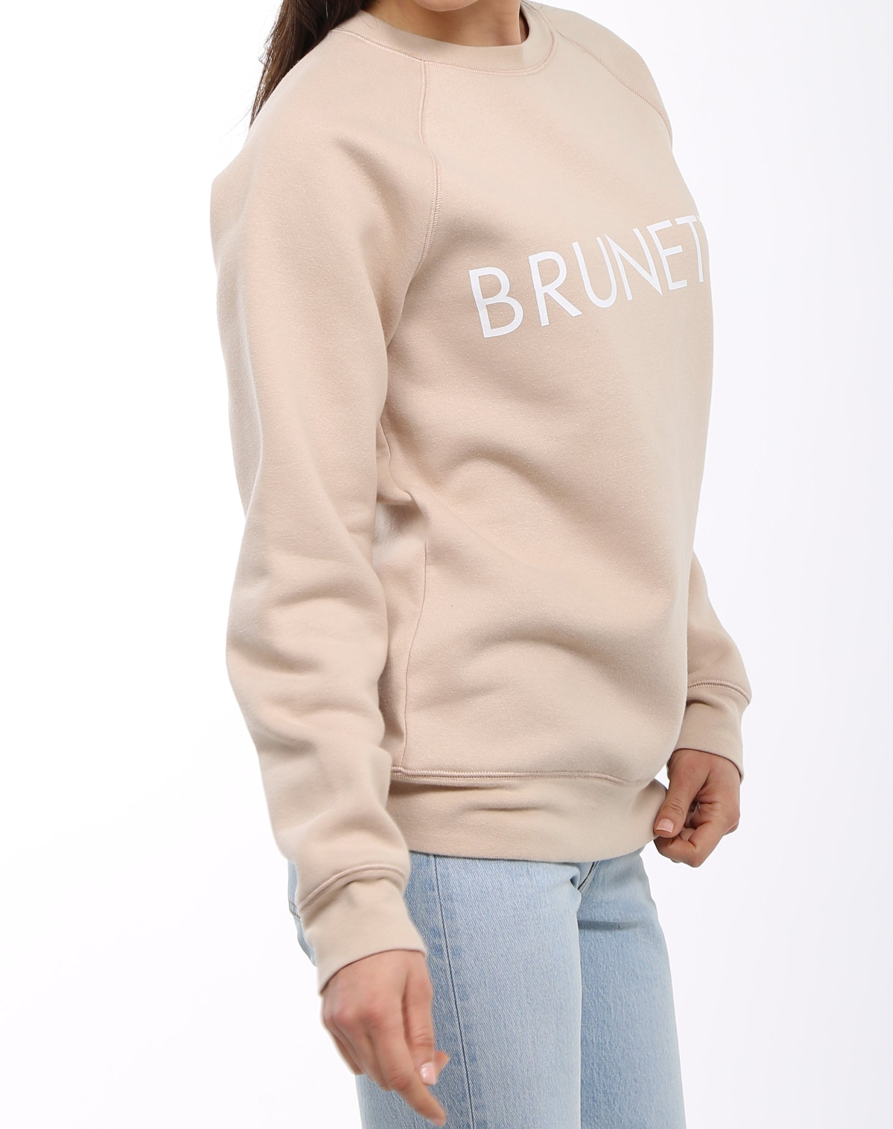 Side photo of the Brunette classic crew neck sweatshirt in toasted almond by Brunette the Label.