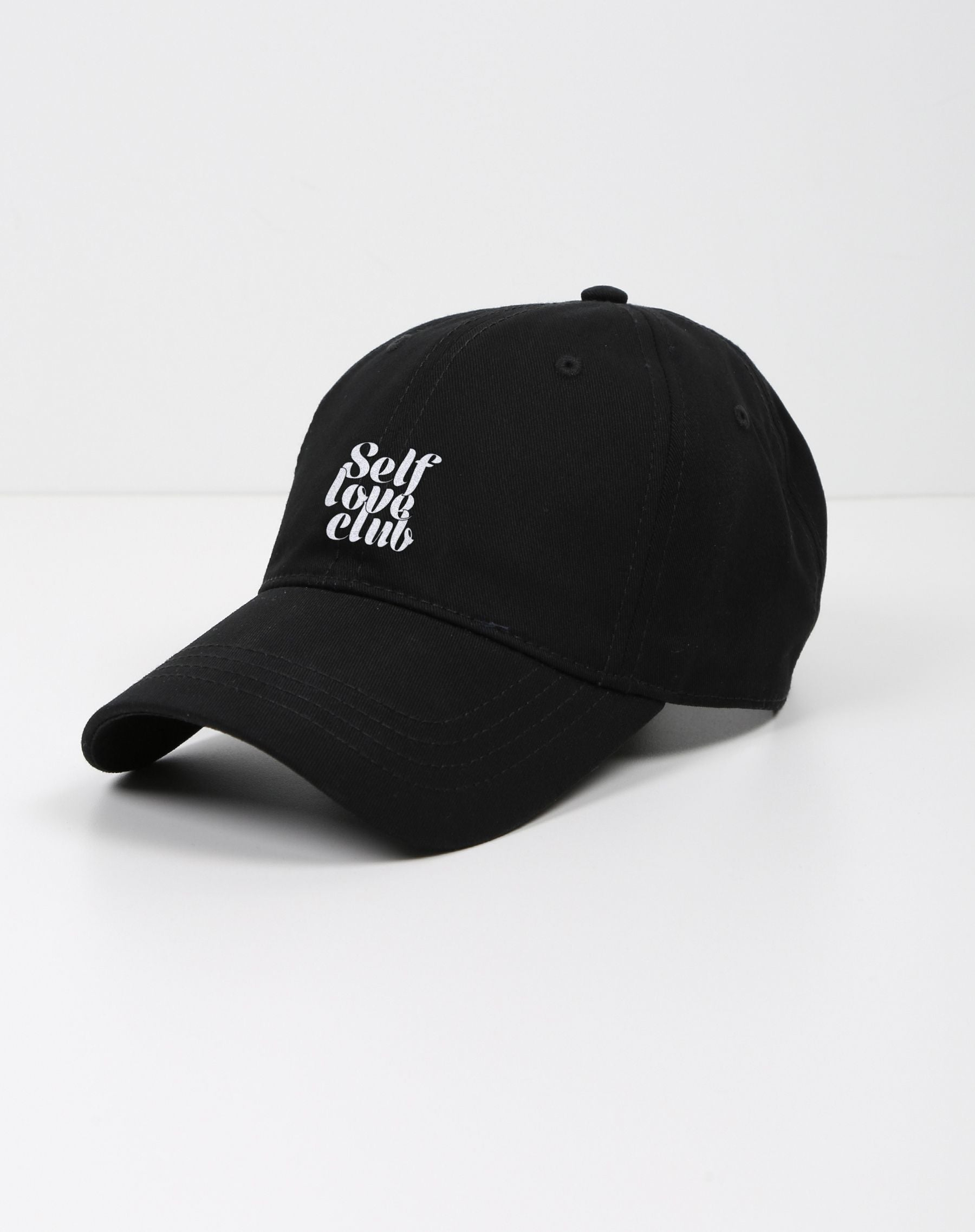 This is a photo of a the self love club baseball cap in black.