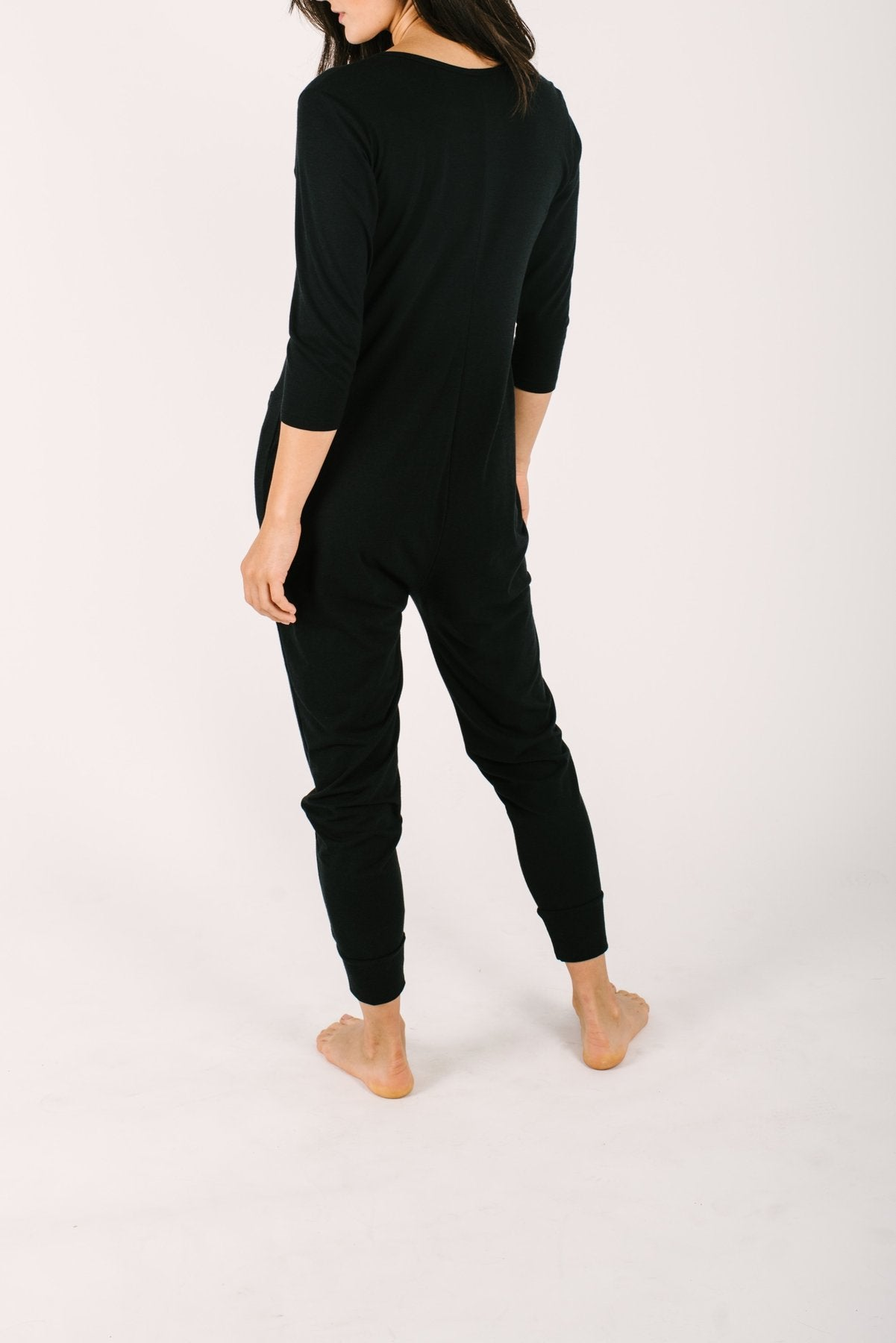 Photo of the back of the Monday Romper in black by Smash and Tess.