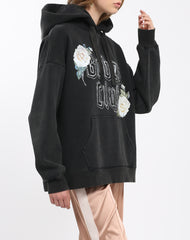 Side view photo of the Babes Club big sister hoodie form the 1981 Collection by Brunette the Label.