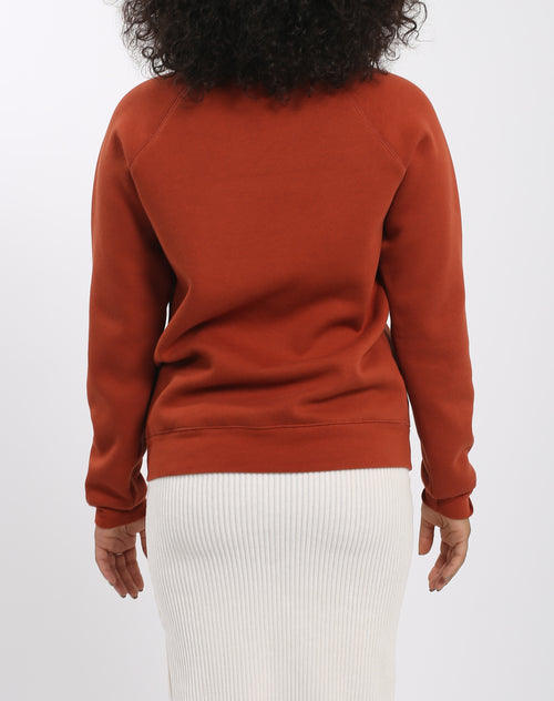 Photo of the back of the Brunette classic crew neck sweatshirt in rust by Brunette the Label.
