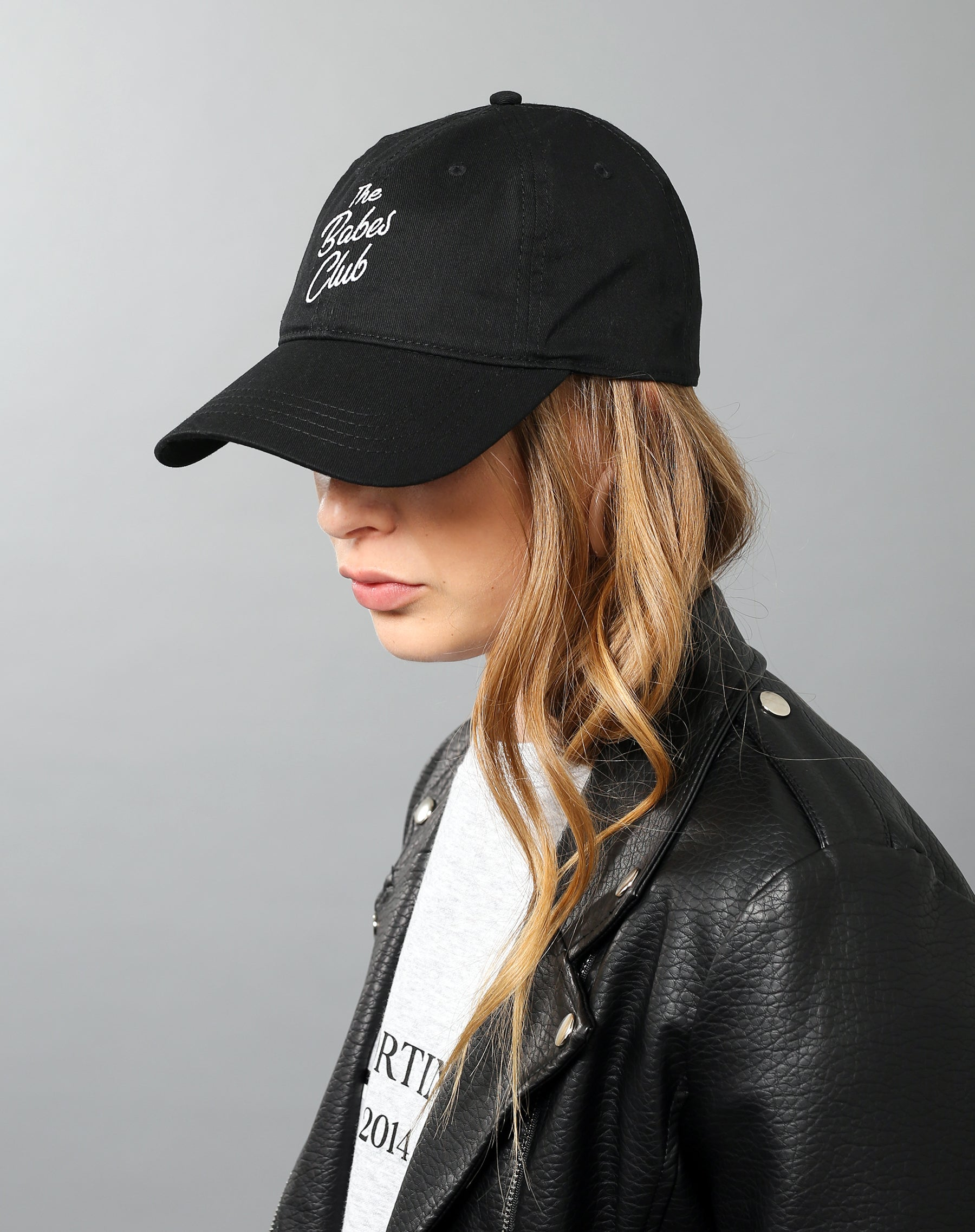 Left side photo of the Babes Club baseball cap in black by Brunette the Label.