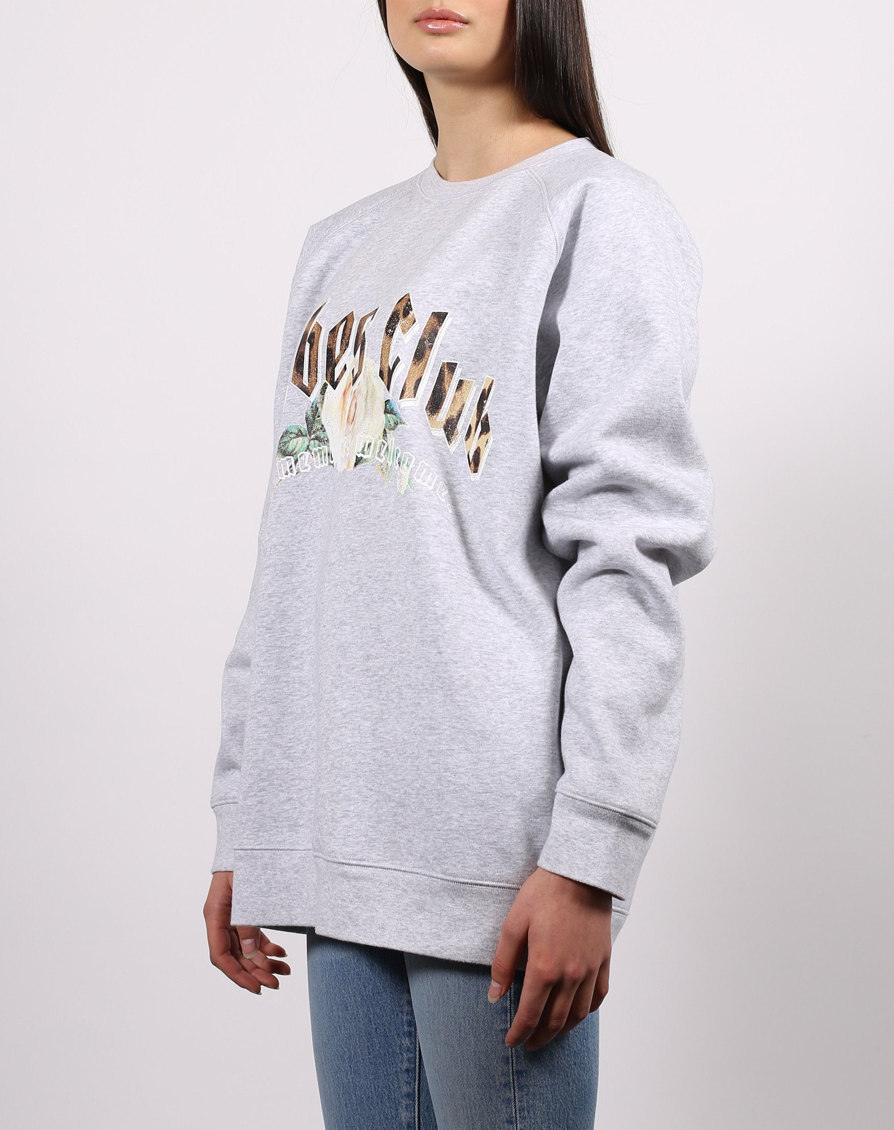 this is a photo of the side of the babes club big sister crew neck sweatshirt in pebble grey from the 1981 collection