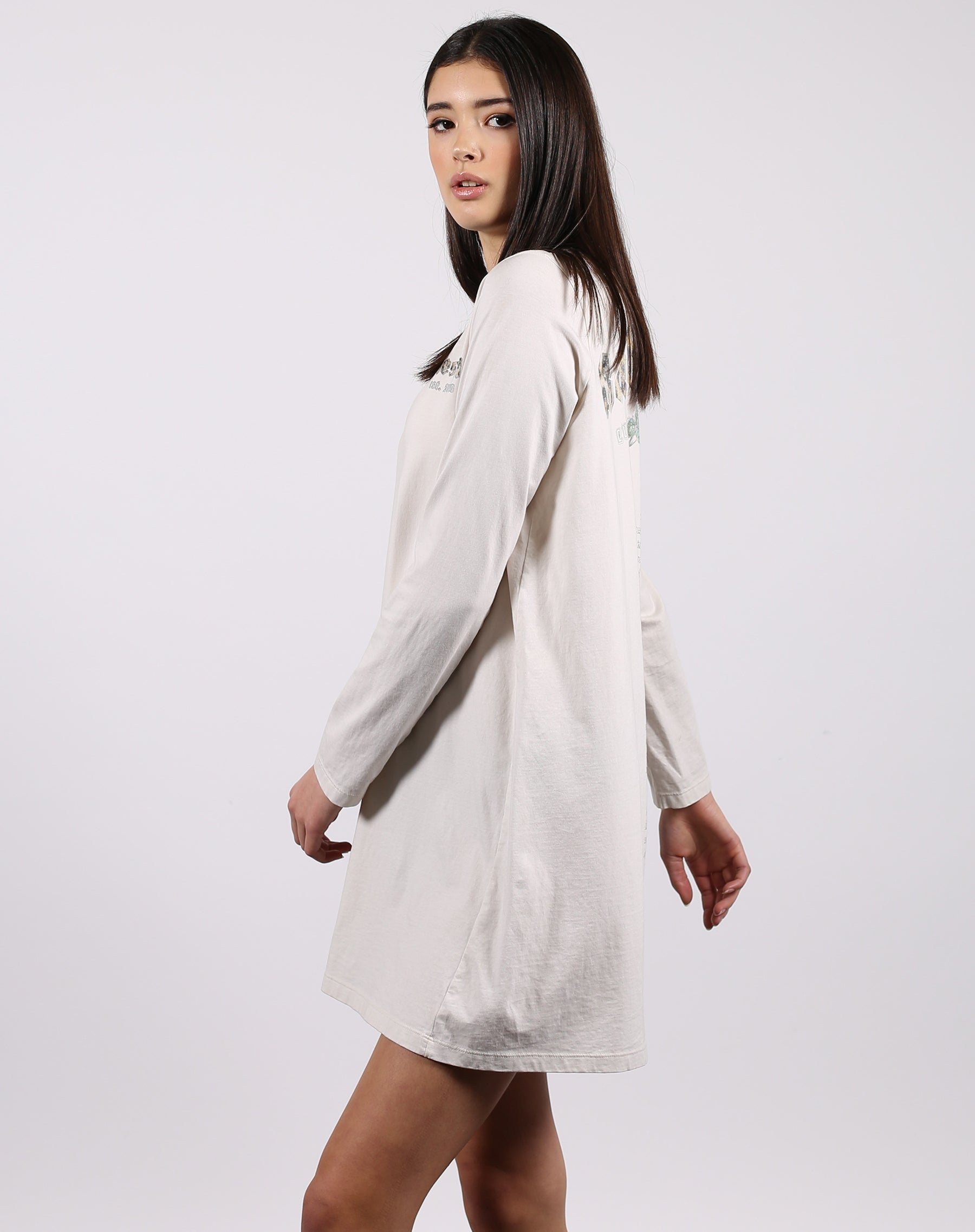 This is a photo of a model wearing the babes club dress in marshmallow by Brunette the Label.